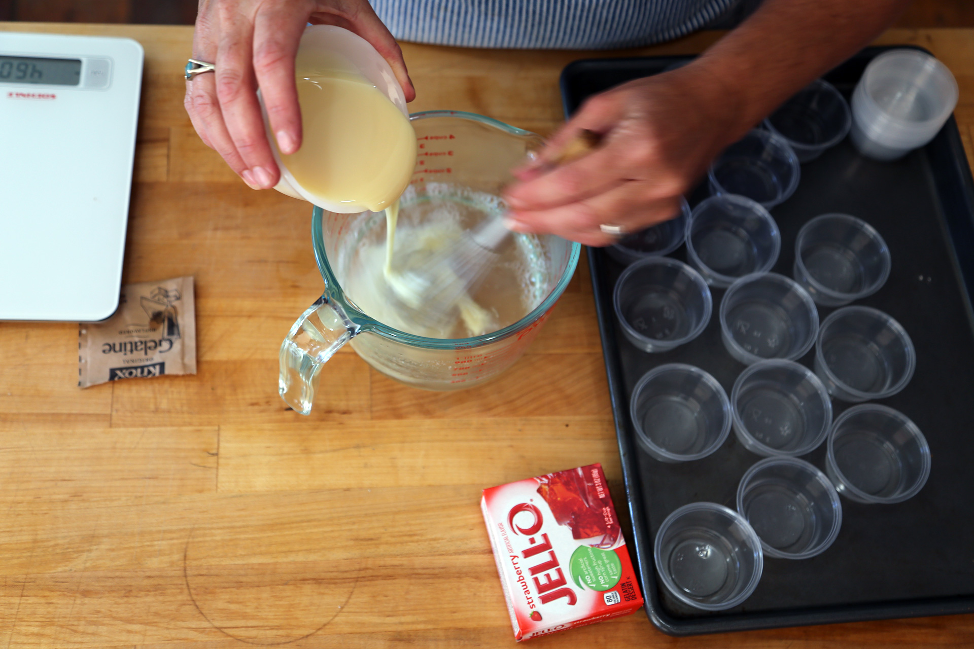 Add the boiling water, stir to combine, then stir in the condensed milk and lemon extract.