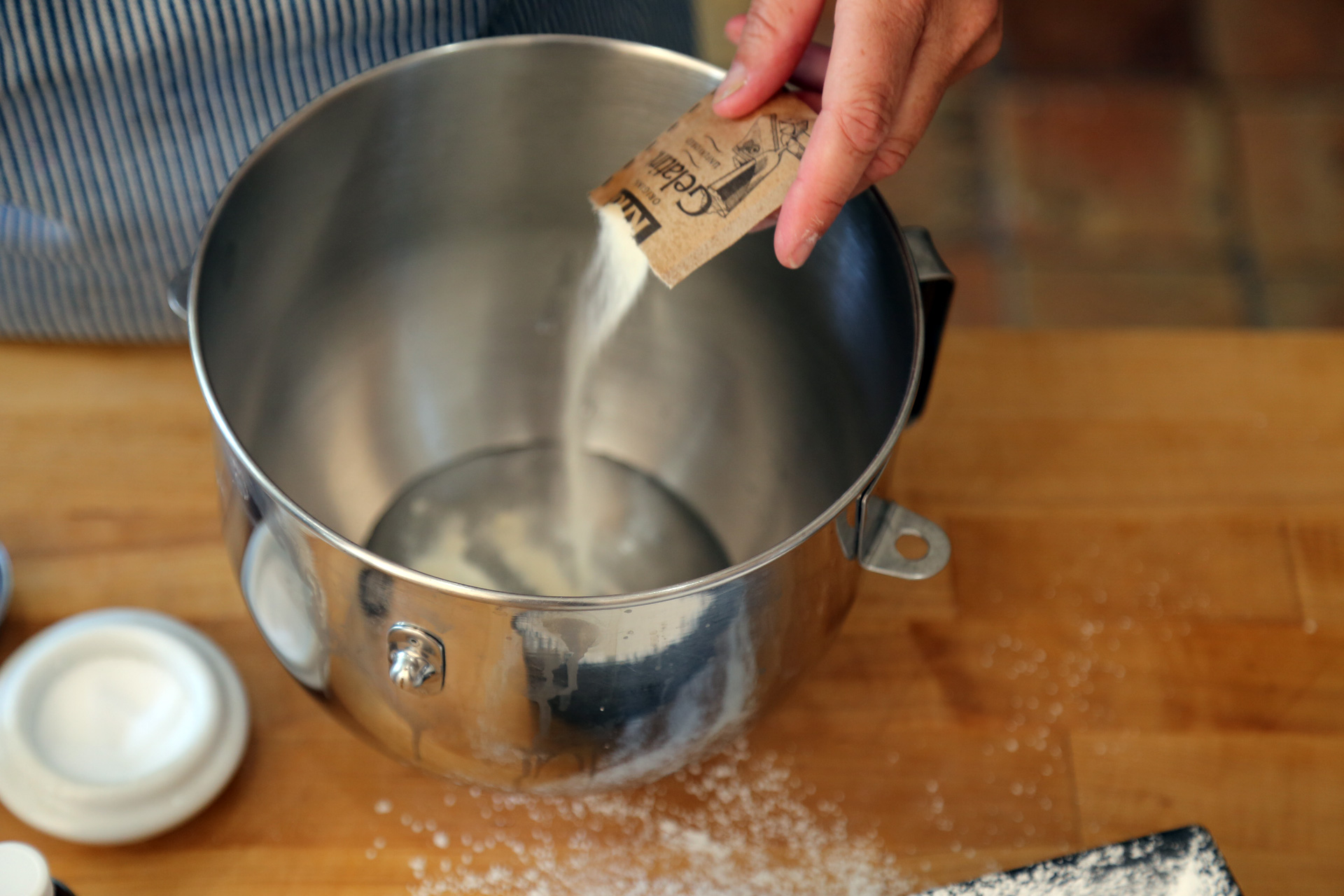 Pour 1/2 cup of cold water into the large bowl of a stand mixer. Sprinkle the powdered gelatin over the water.