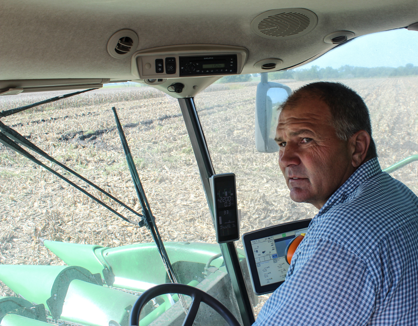 "Kansas Farmer Mark Nelson says he's too busy with harvest to think much about abstracts, but he admits that the prospect of depending on fewer and fewer, larger and larger companies for his seed, fertilizer and chemicals is ""a little nerve wracking."""