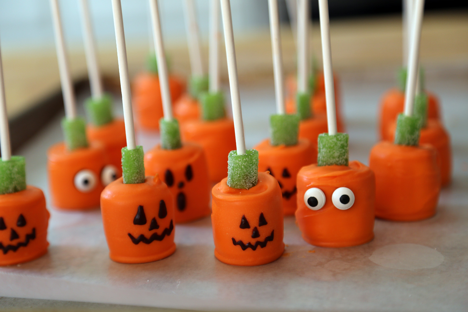 Alternatively, put a blob of chocolate on the pumpkins and add candy eyeballs.