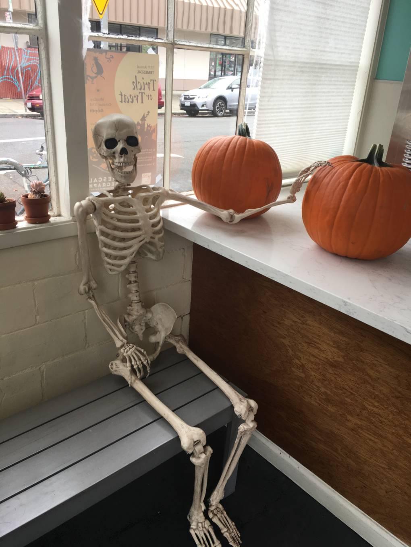 Curbside Creamery Skeleton with Pumpkins