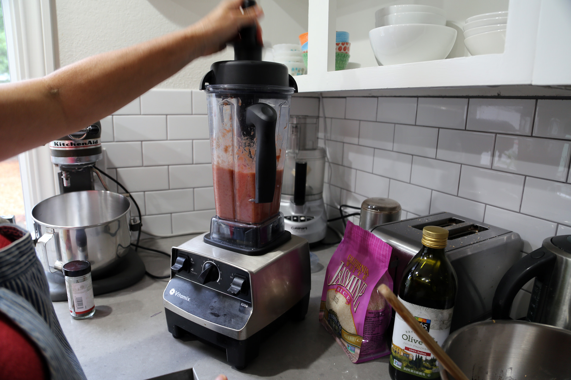 In a blender, puree the tomatoes with juices, onion, and garlic until smooth.