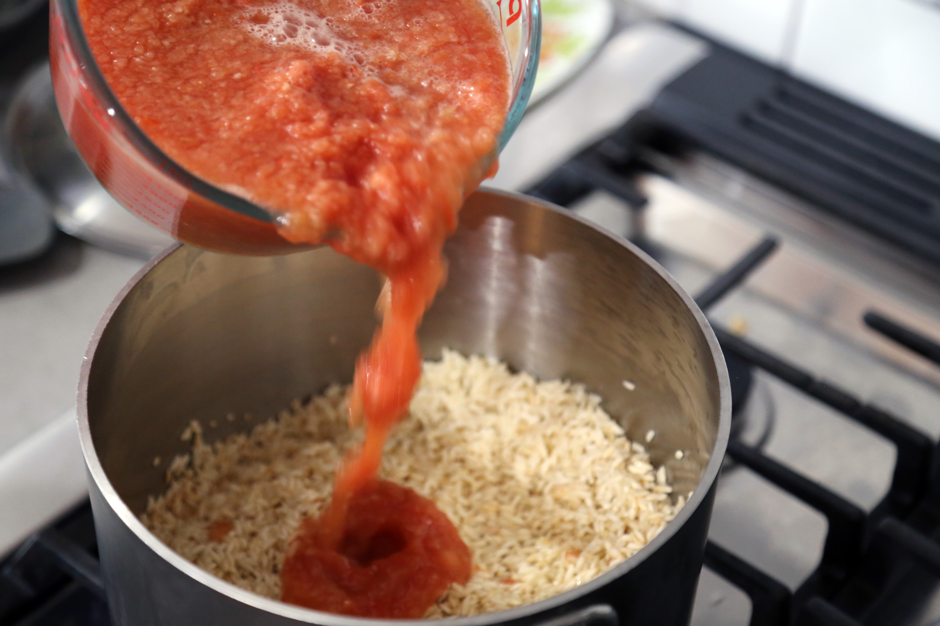Pour the tomato mixture over the rice.