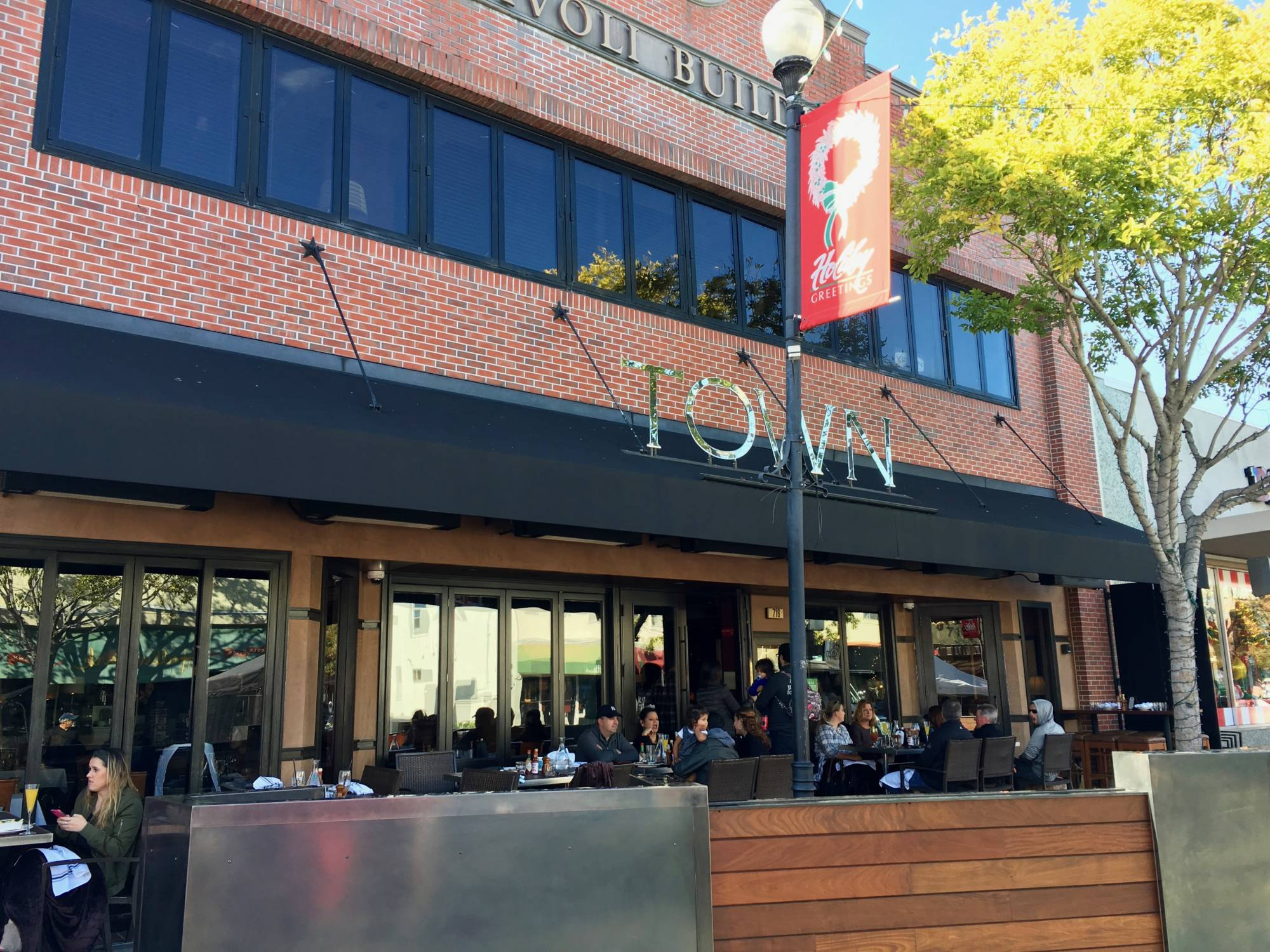 Guests having brunch on the patio at Town in San Carlos.