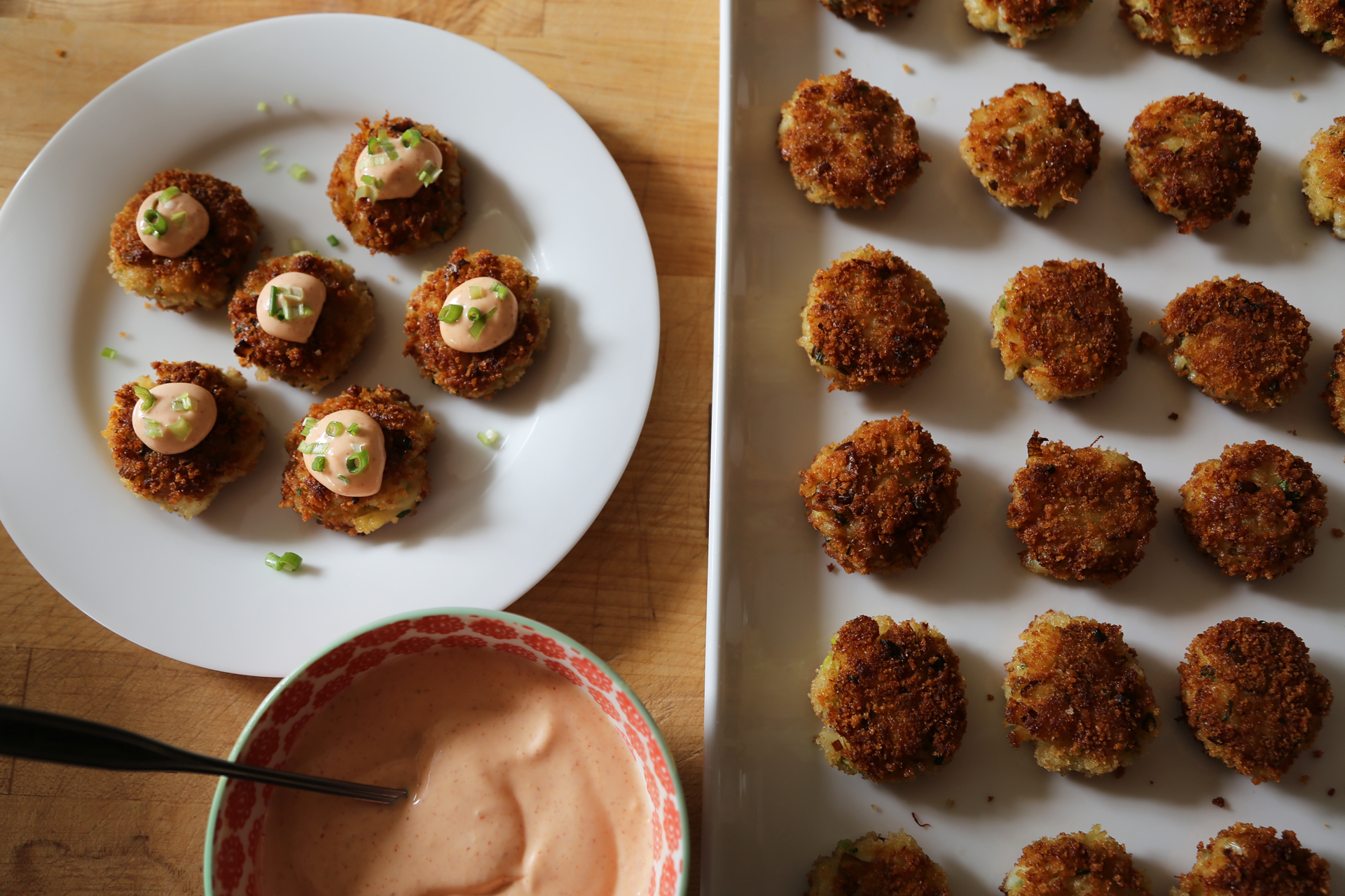 Serve at once with the spicy mayo alongside, or, for passed hors d'oeuvres, place the crab cakes on a platter, top with a little dollop of mayo and a sprinkle of green onion.