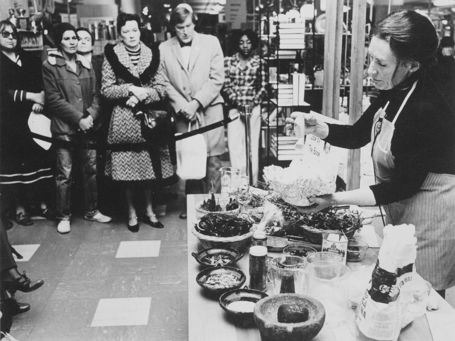 Kennedy gives a cooking demonstration at Bloomingdale's in New York City in 1972.