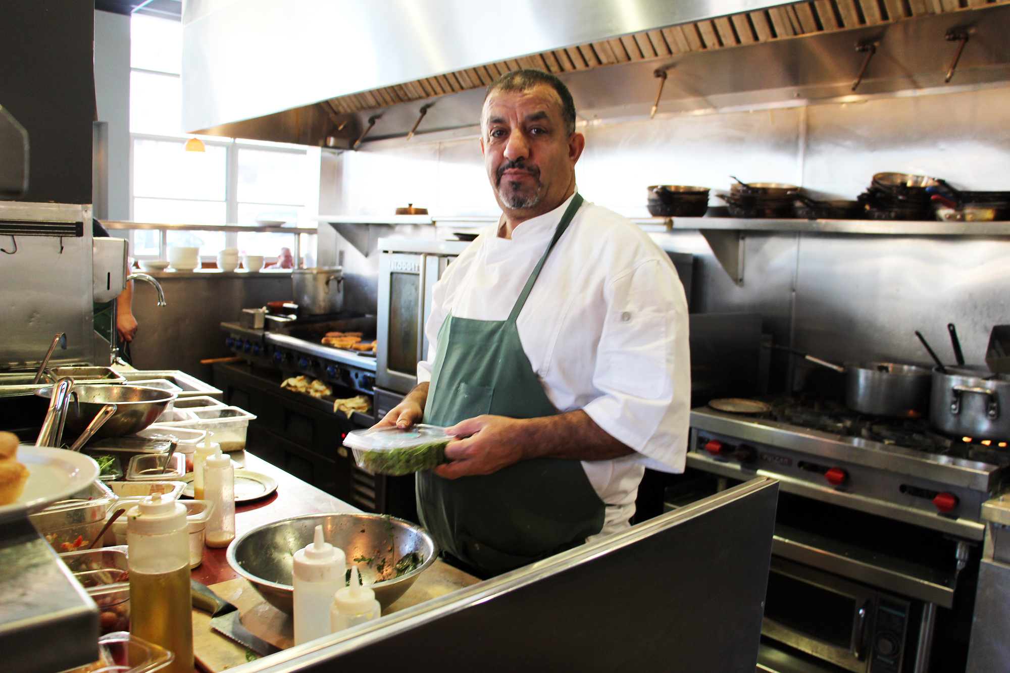 Chef/Owner Mohamed Aboghanem in Saha open kitchen.