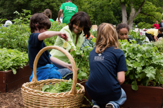 First Lady Michelle Obama harvests vegetables with students in the White House Kitchen Garden on the South Lawn, May 28, 2013.