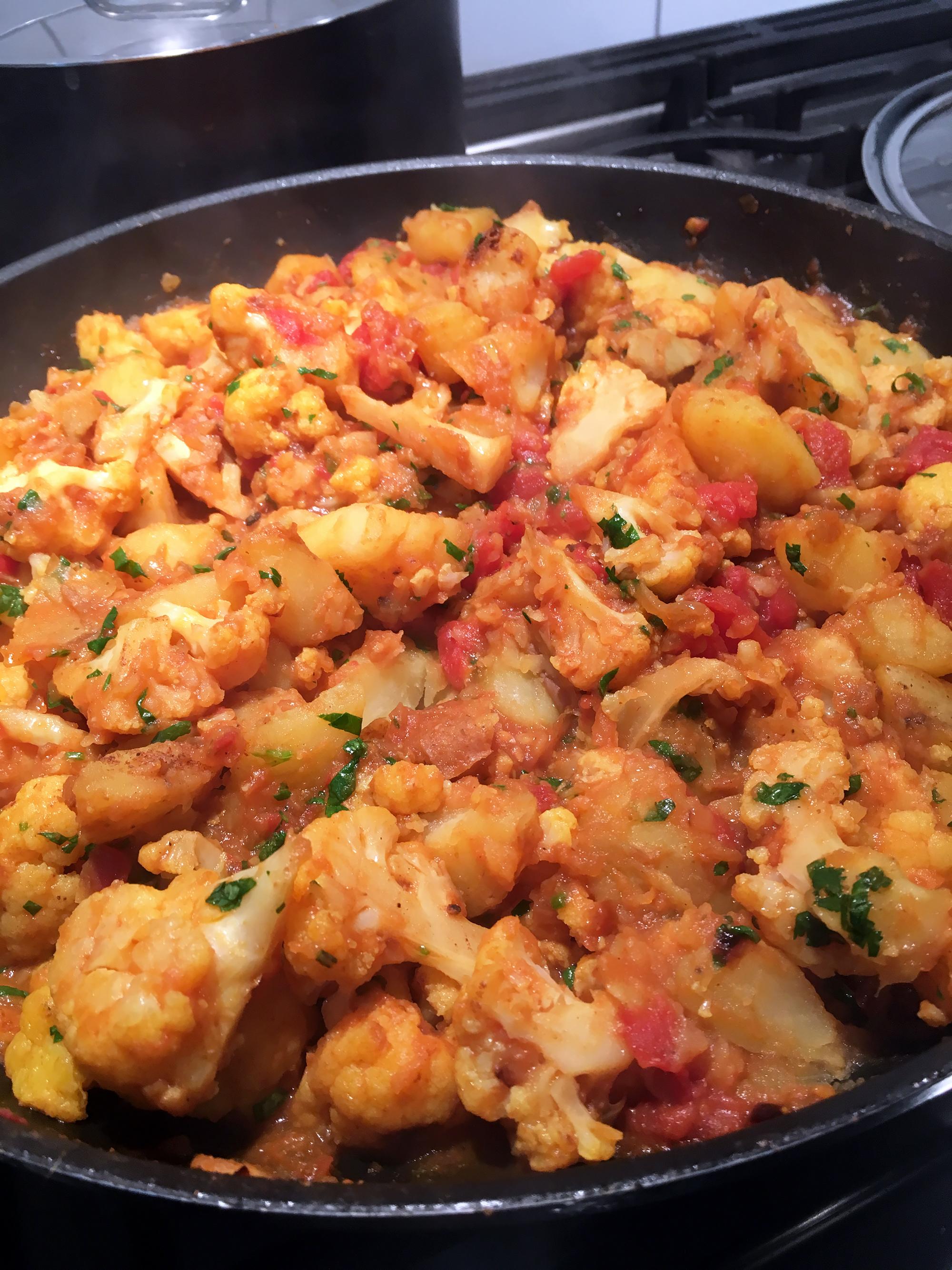 Stir in the garam masala and cilantro.