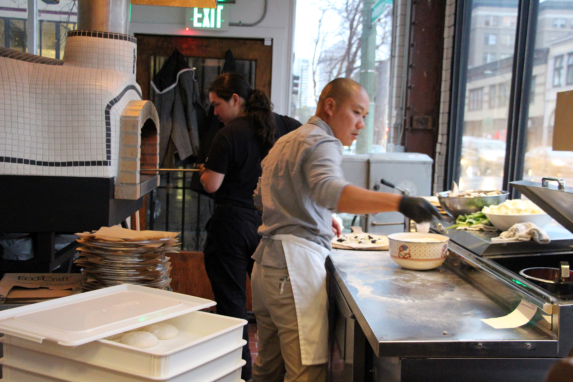 Making pizza in the open kitchen at Bare Knuckle.