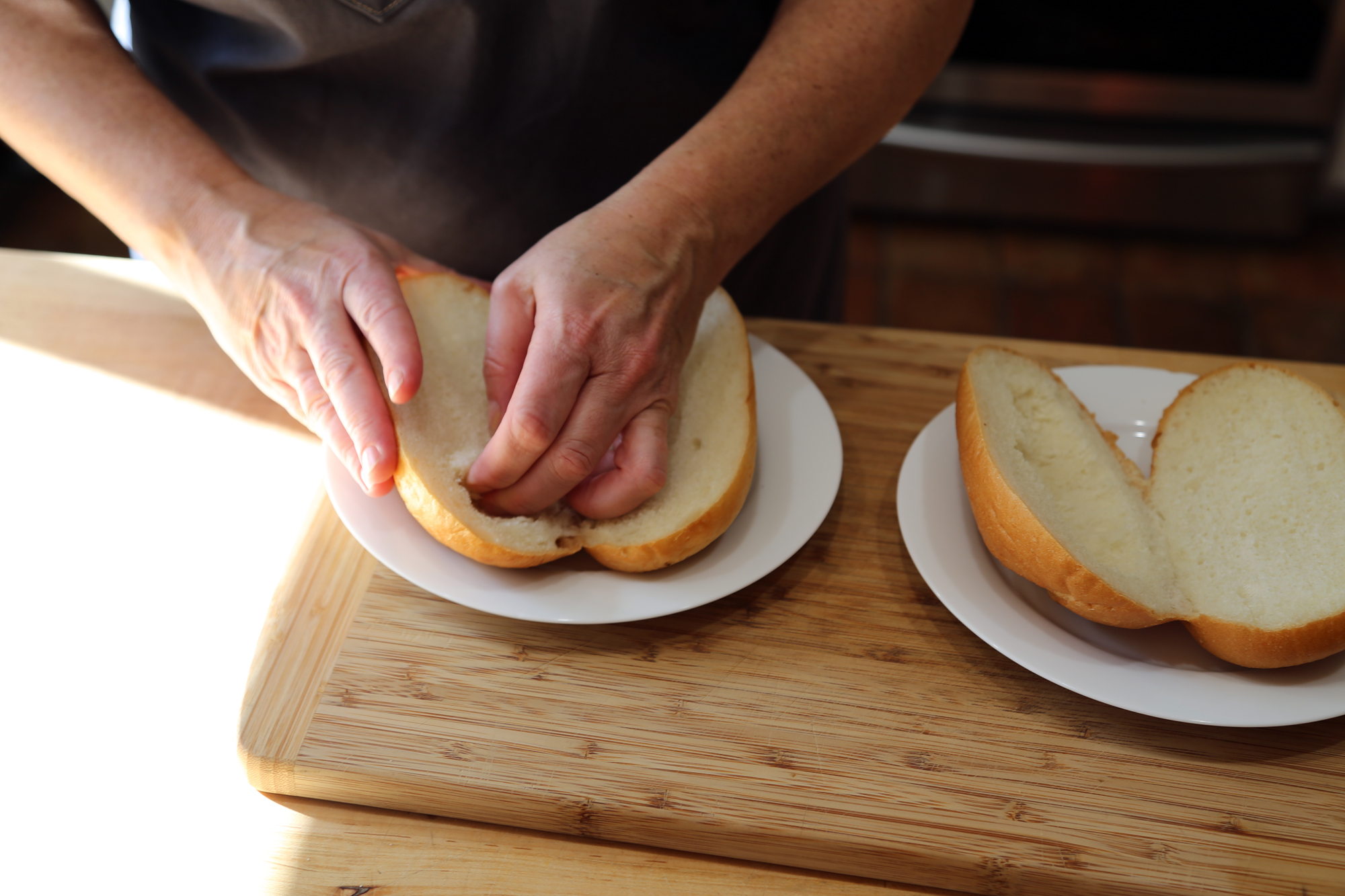 To make the sandwiches, split the rolls, and roughly hollow out the top.