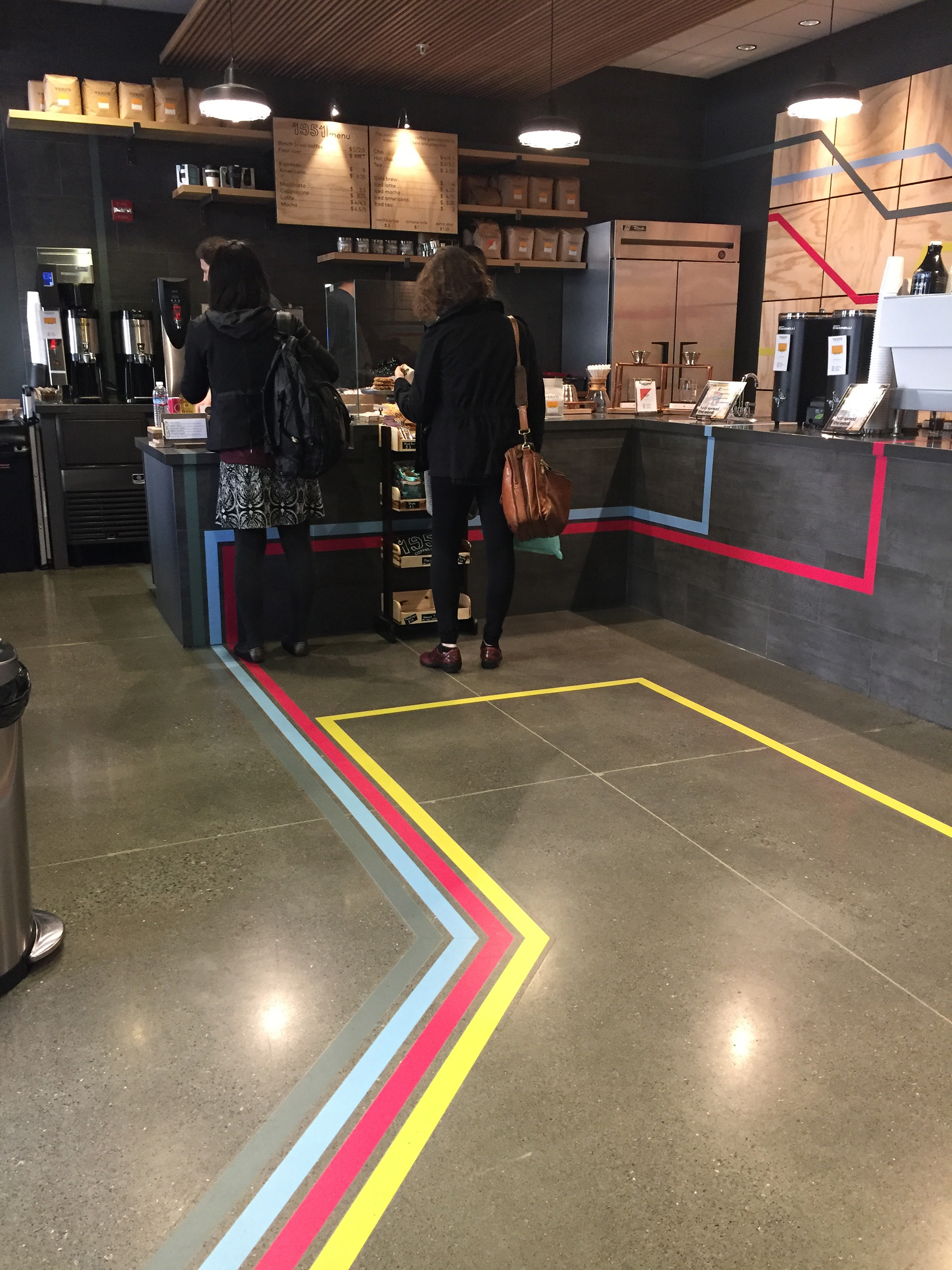 The colorful stripes on the cafe's floor suggest the long journey to resettlement.