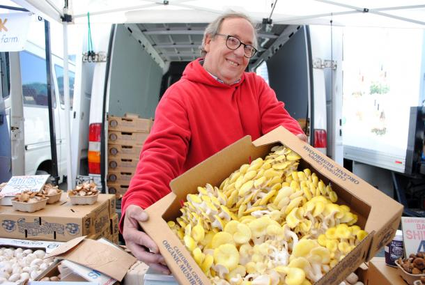 John Garrone (shown with yellow oyster mushrooms) can be found at the Ferry Plaza Farmers Market on Saturdays.