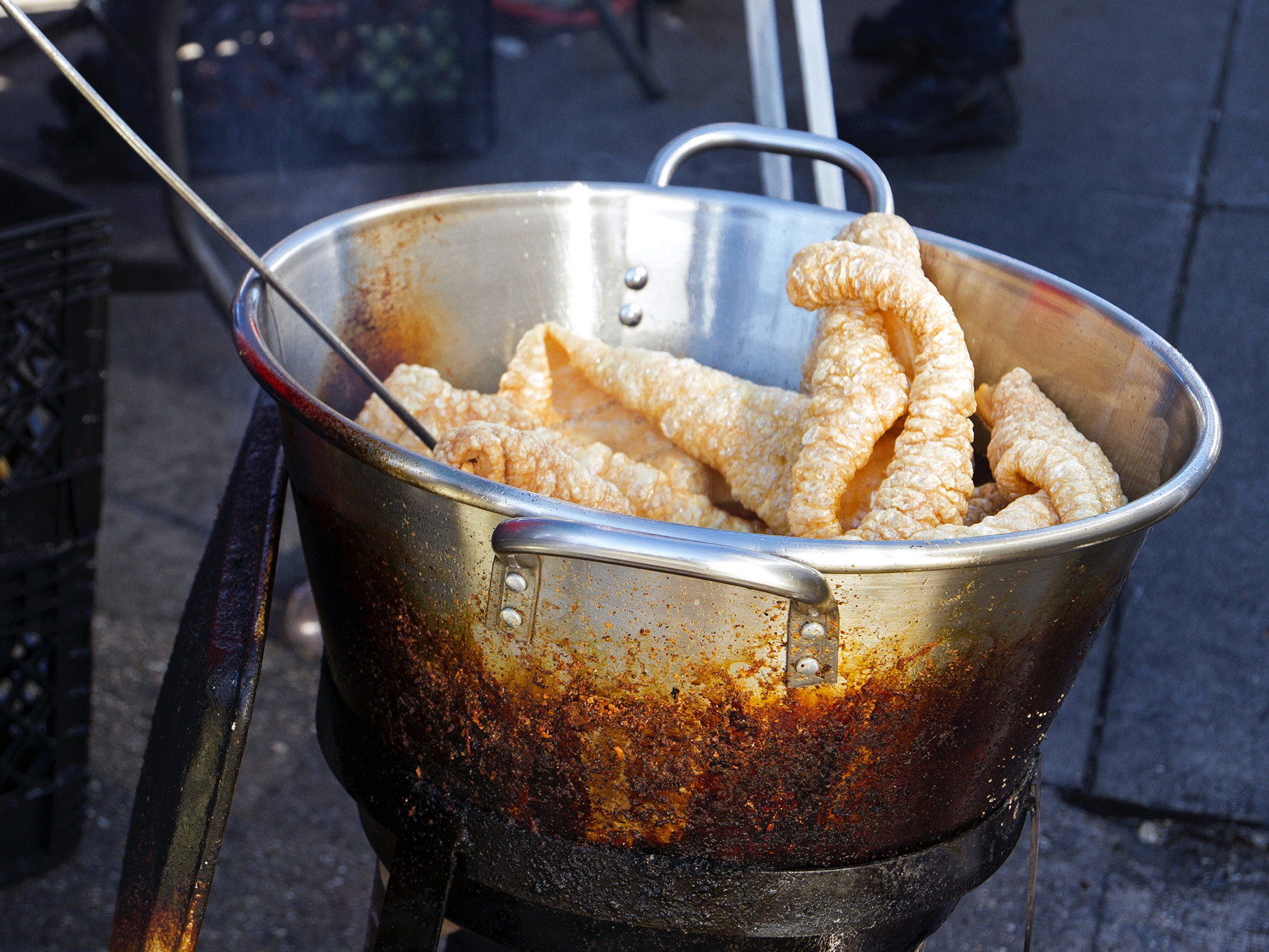 Chicharrones, or pork rinds, fry in the piñata district in Los Angeles.