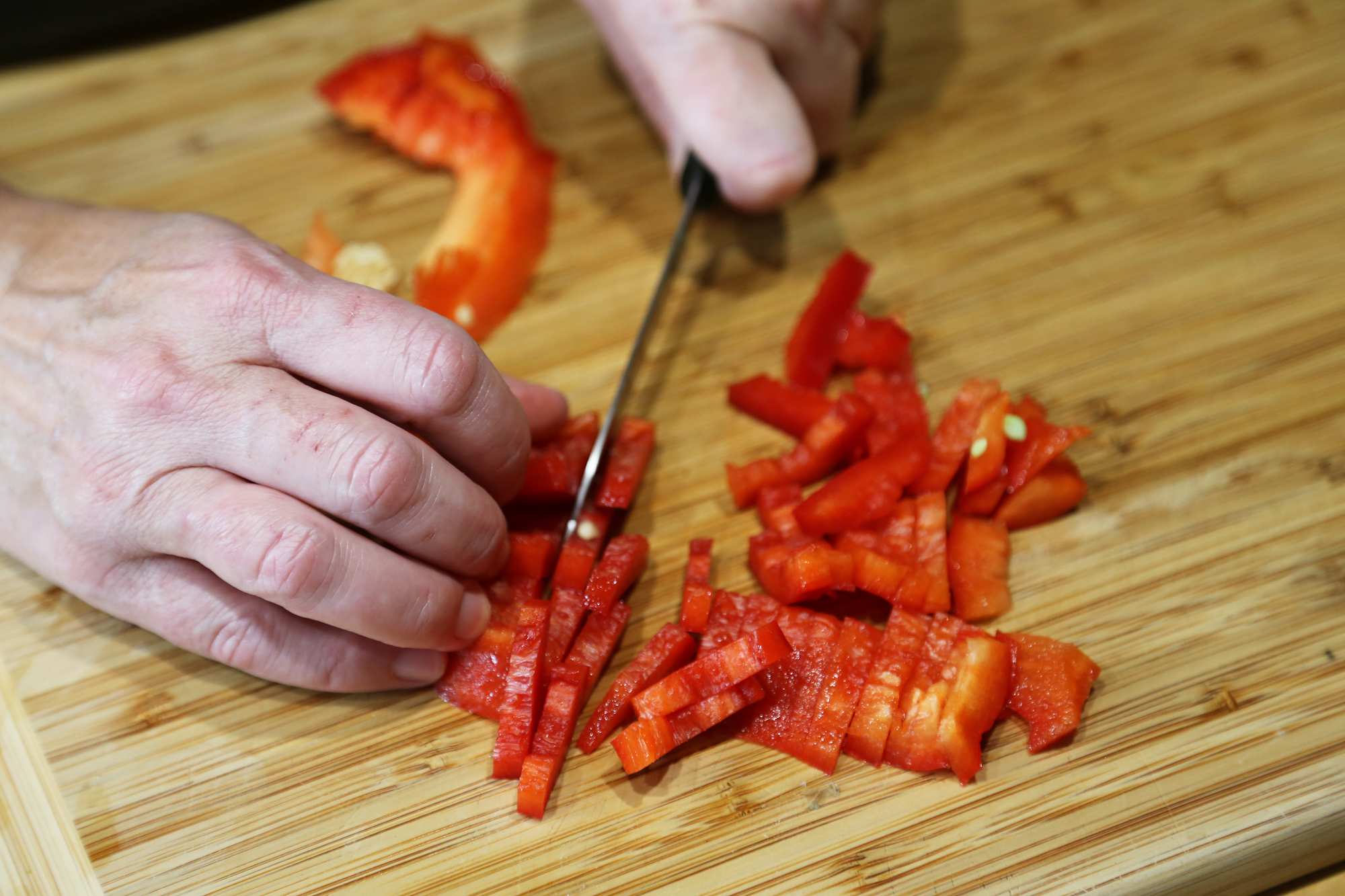 Seed and cut red bell pepper into thin 1-inch strips.