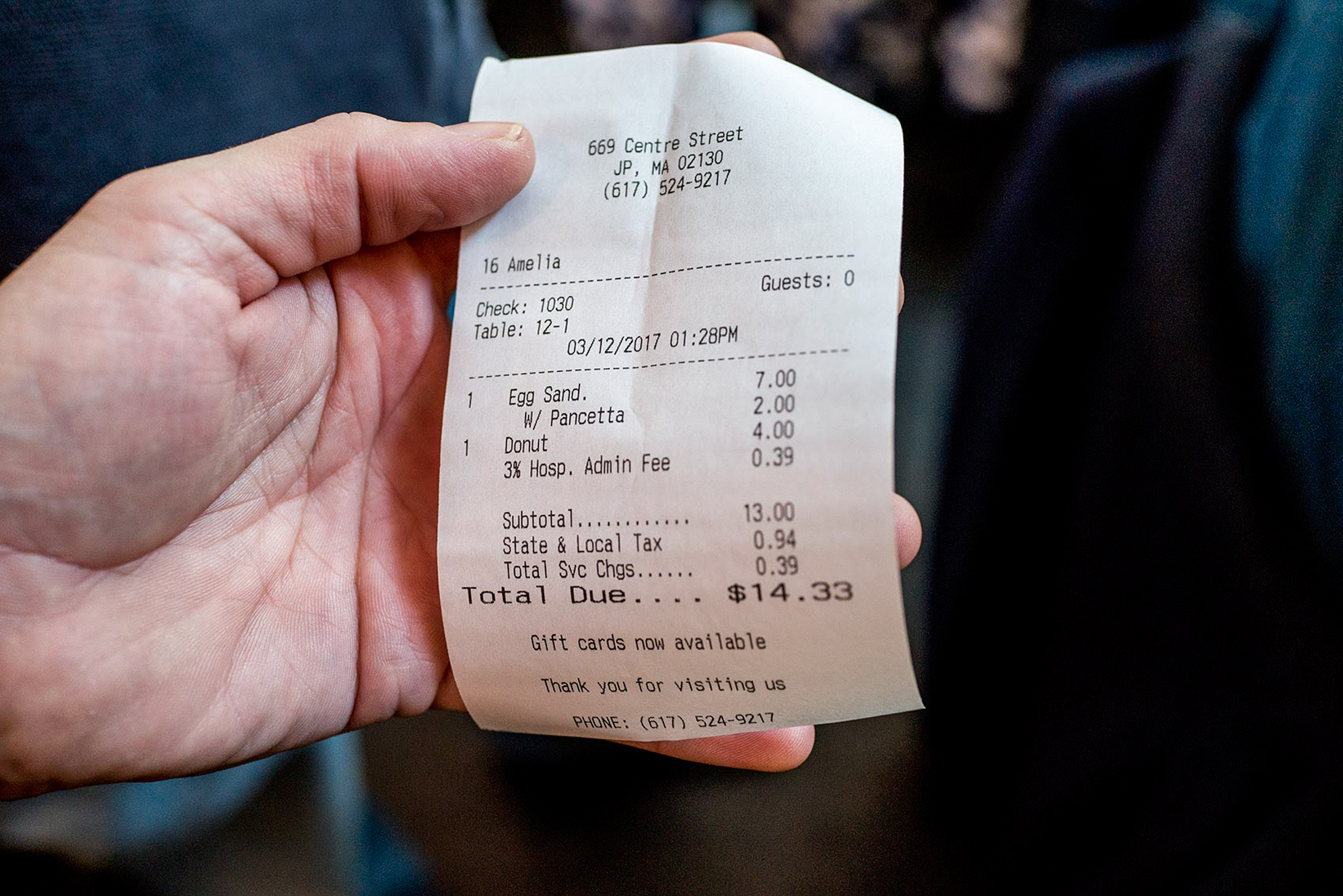 """A receipt from Centre Street Café in Boston includes a 3 percent """"hospitality administration fee,"""" which comes out to 39 cents on $13 of food sales. The entire fee goes to non-tipped employees in the kitchen."""