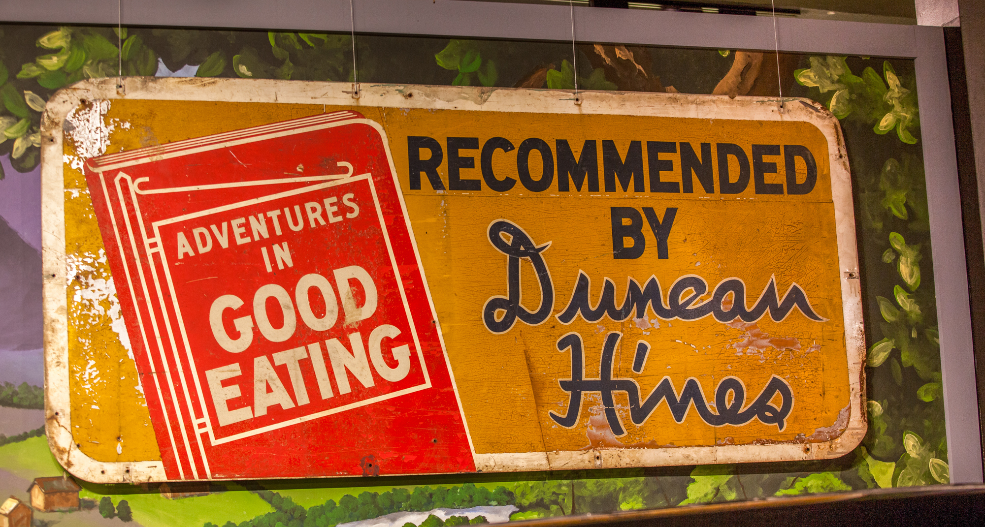 A roadside sign advertising Duncan Hines' Adventures in Good Eating is on display at the Kentucky Museum at Western Kentucky University.