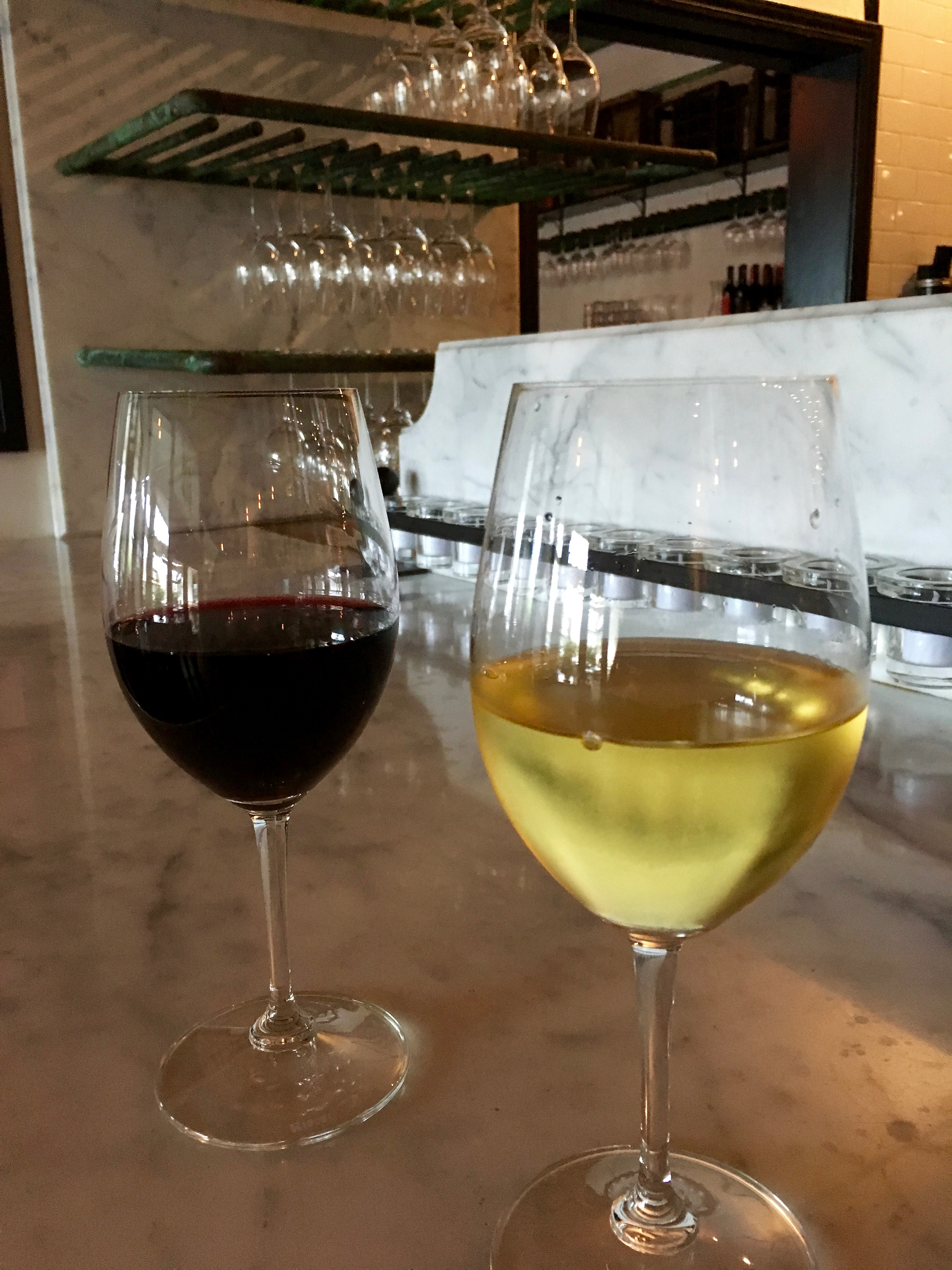 A glass of nero d'avola and rioja blanco at Enoteca La Storia.