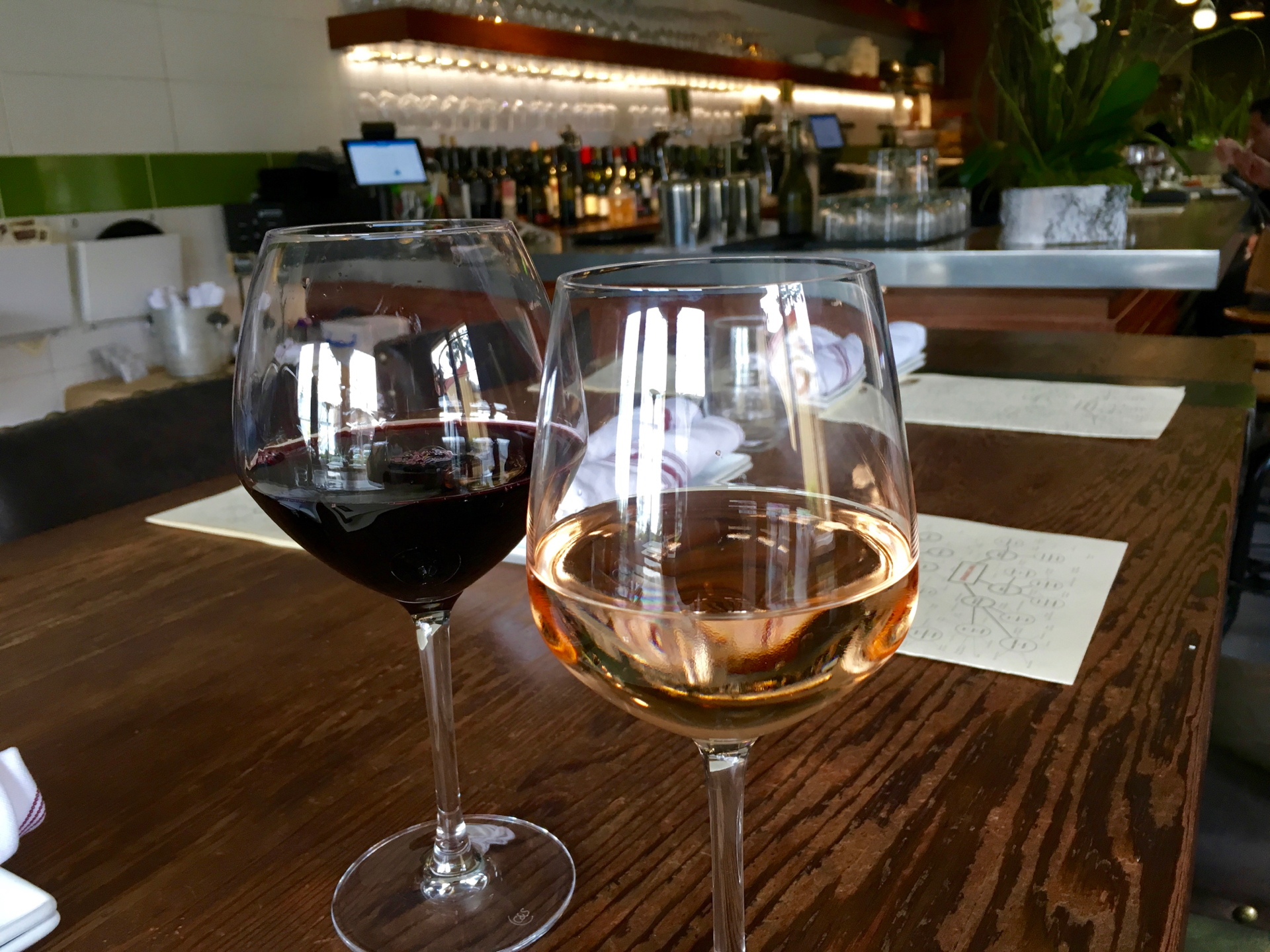 A glass of zinfandel and rose at Rootstock Wine Bar.