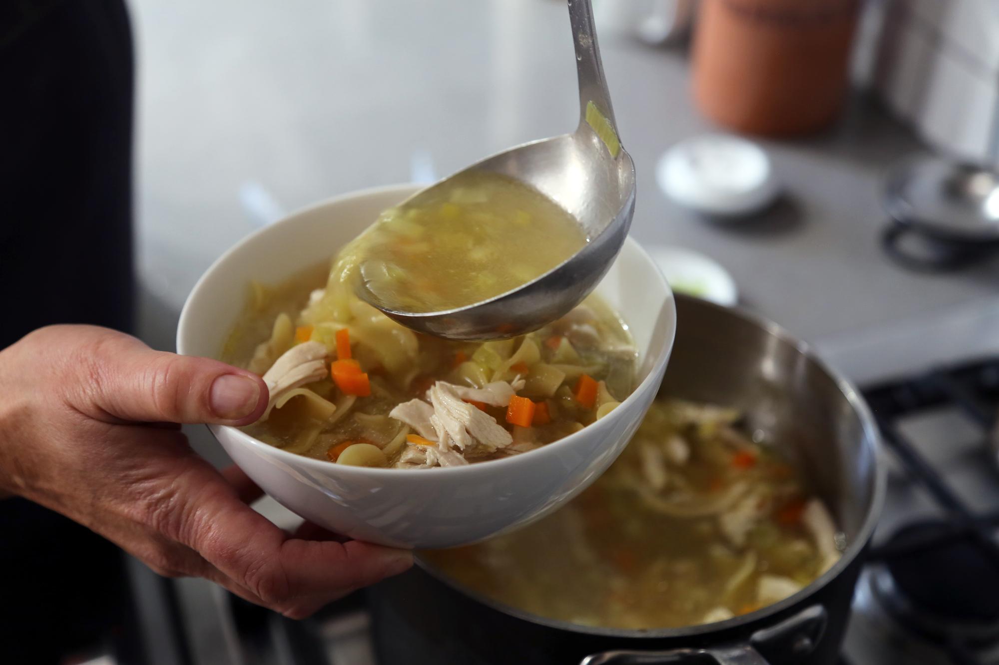 Ladle the hot soup into bowls.