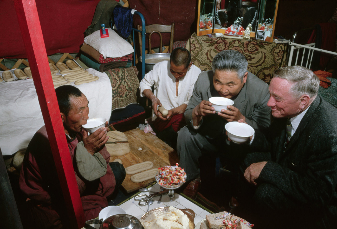 American Supreme Court justice William O. Douglas drinks fermented horse milk with herders in a yurt during his visit to Mongolia in 1961.