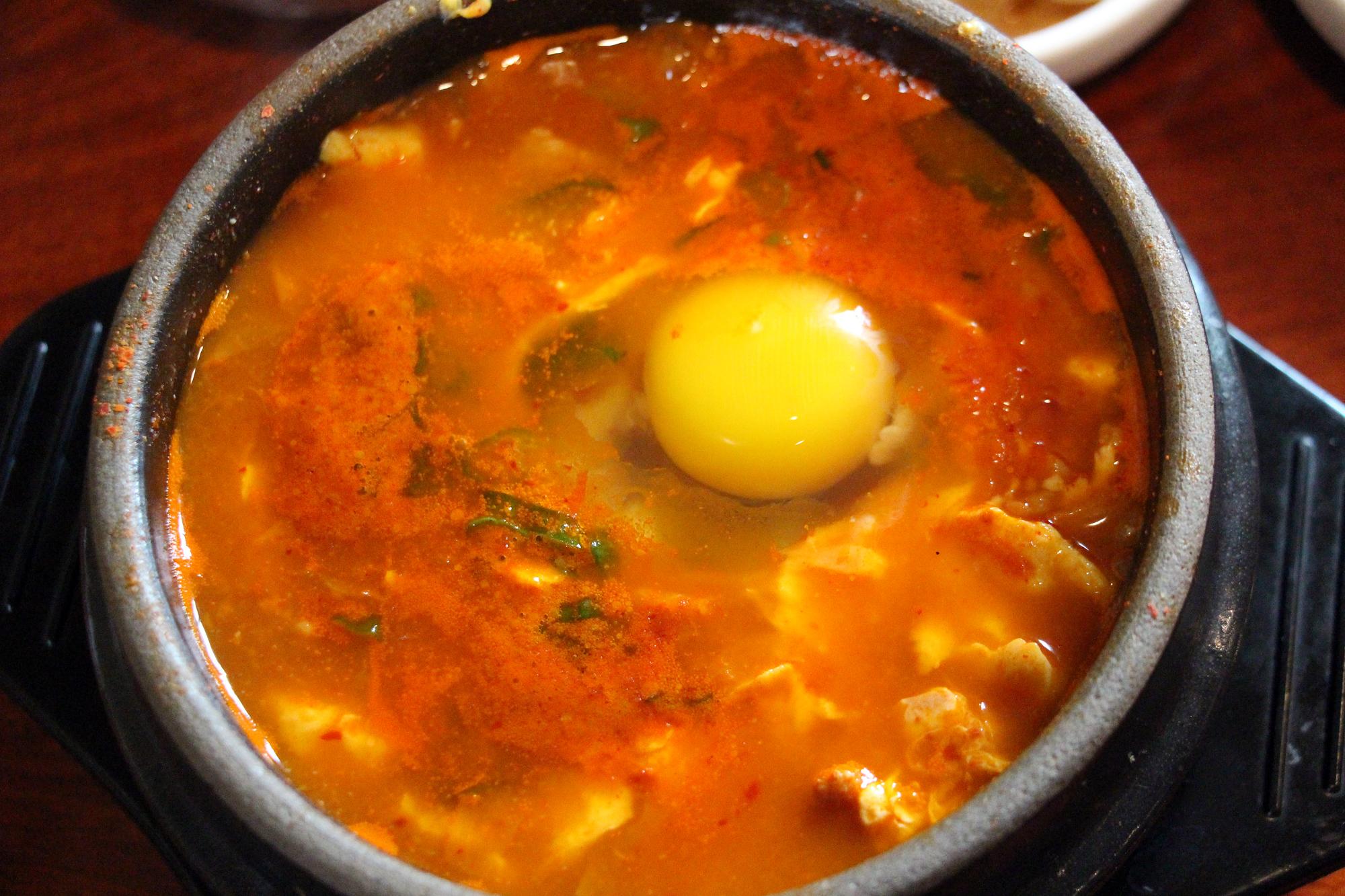 Soft tofu soup with pork, kimchi and a raw egg