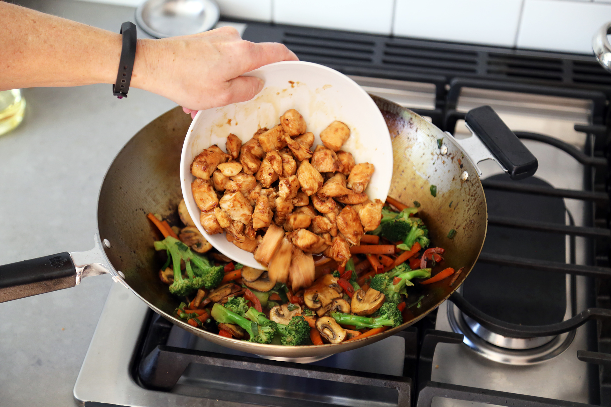 Add the chicken back to the wok along with the sauce.