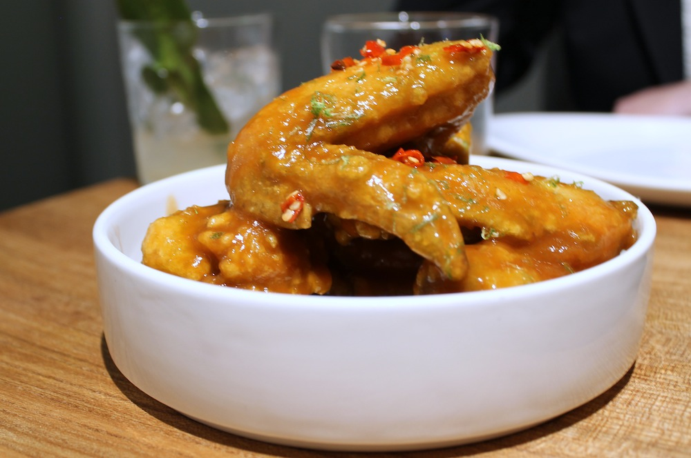 Kin Khao's Pretty Hot Wings are glazed with a sriracha and tamarind sauce.