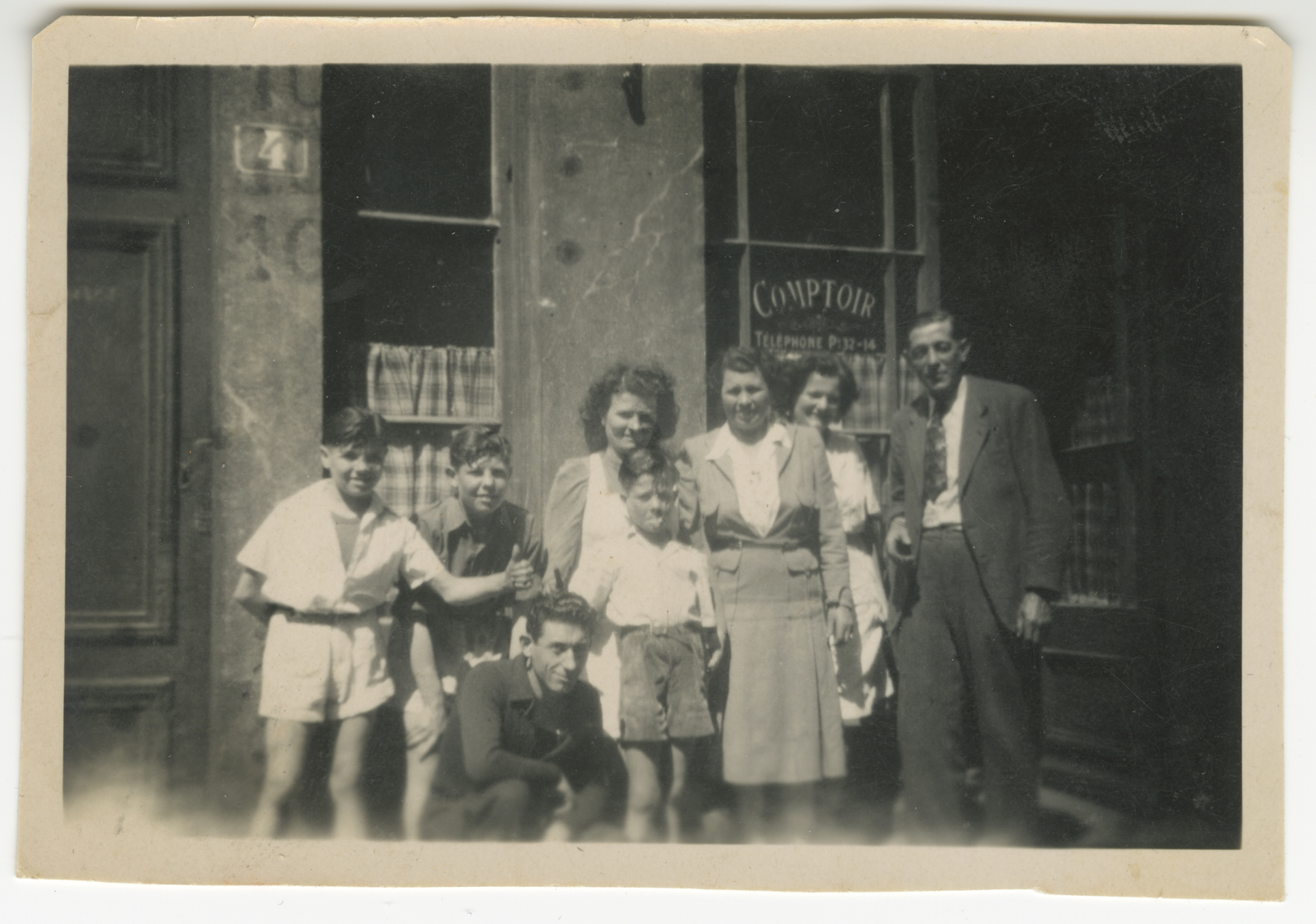 Jacques Pépin (left), his brother Roland, his mother Jeannette, his younger brother Bichon, and aunts and uncles in front of the family restaurant, Chez Pépin.