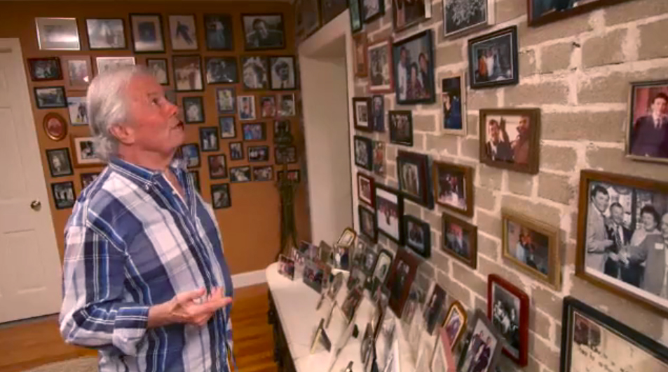 Jacques Pépin nearing his 80th birthday, contemplates a wall filled with framed pictures of close friends and people who have been influential in his life.
