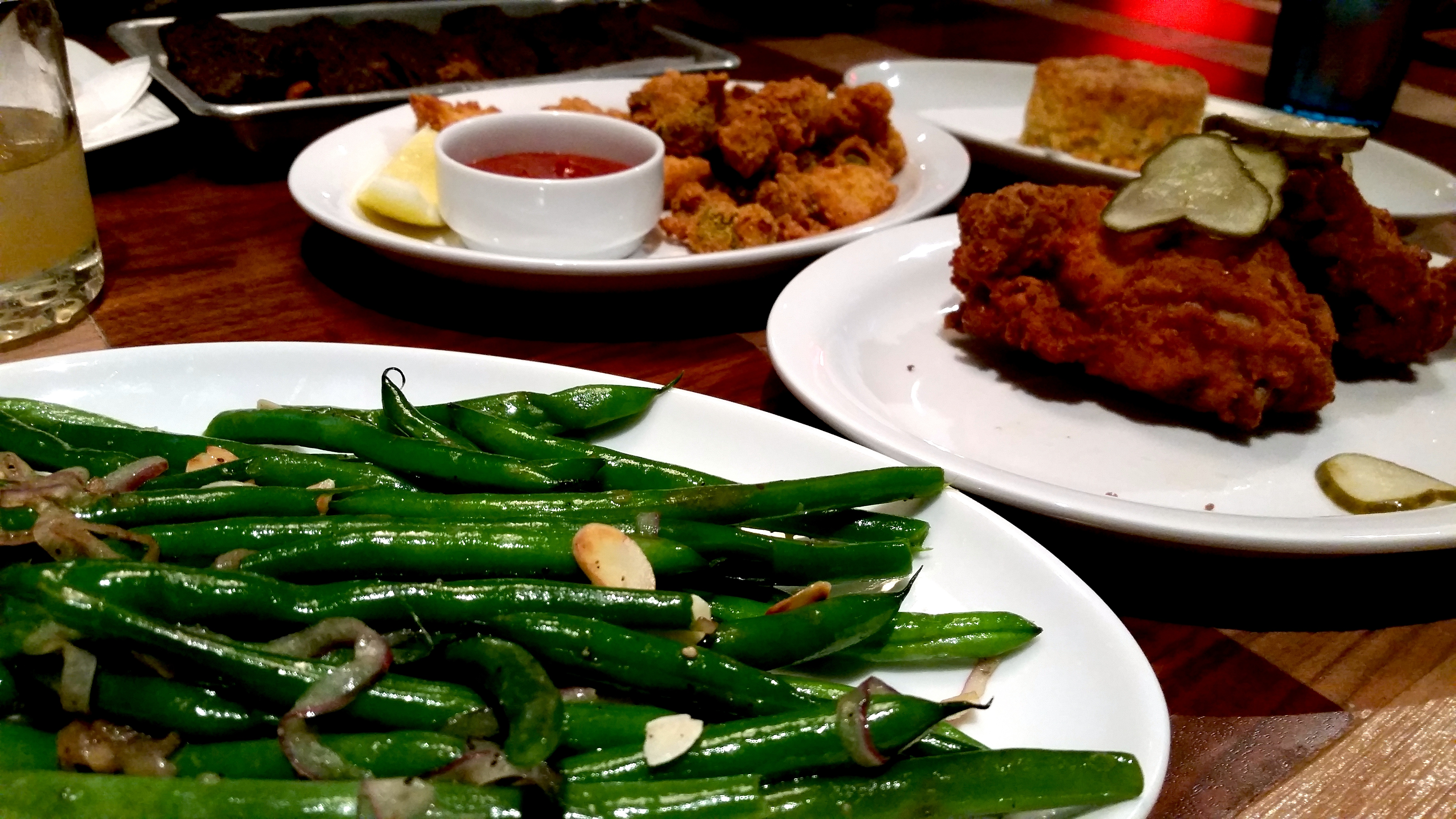 Green beans, chicken, gator bites, and biscuit plates