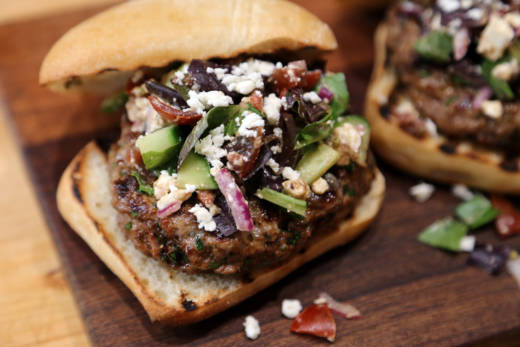 Herbed Lamb Burgers topped with Chopped Greek Salad