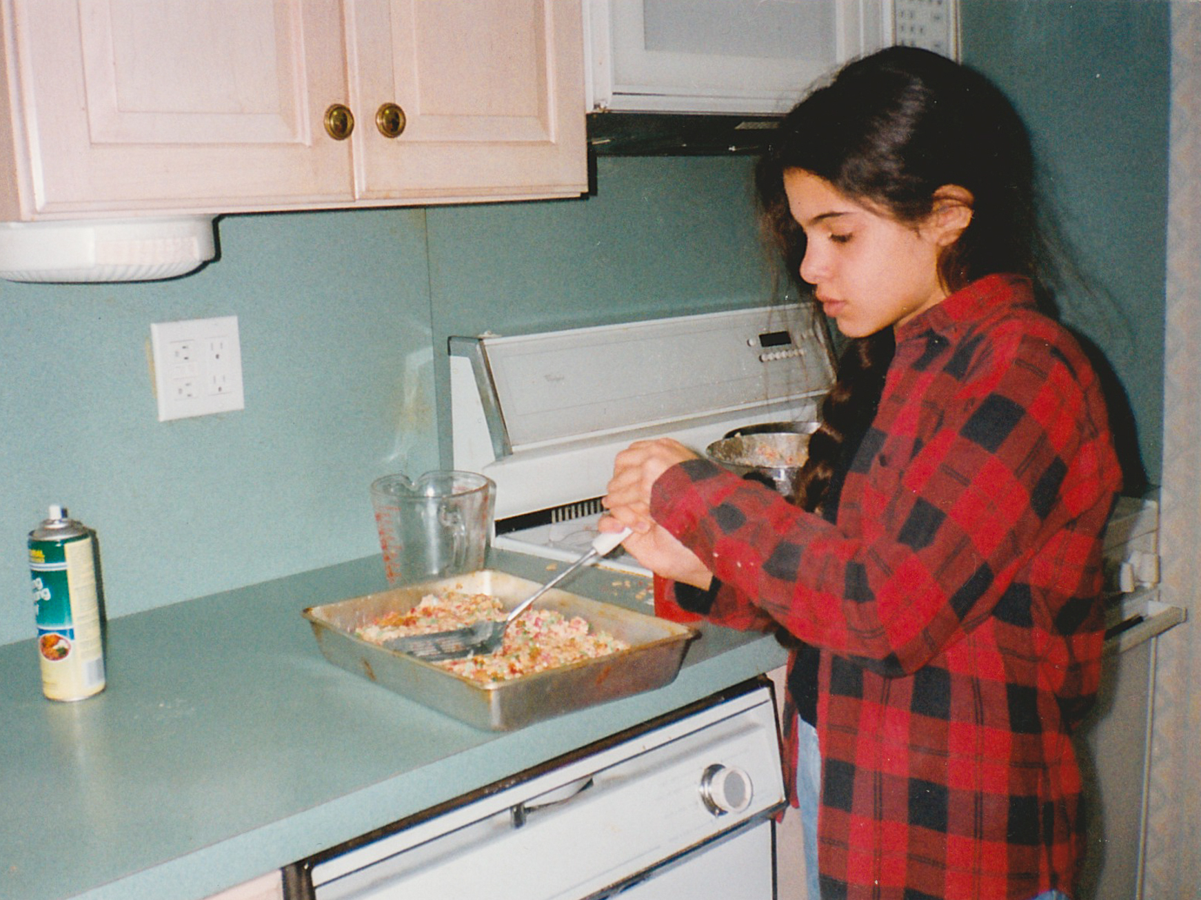 "Liz Alpern baking Rice Krispies treats as a child. Alpern was one of the storytellers at Schmaltzy. She says growing up, her Long Island family was not known for cooking. ""We made cookies that you sliced and put in the oven. That was baking."""