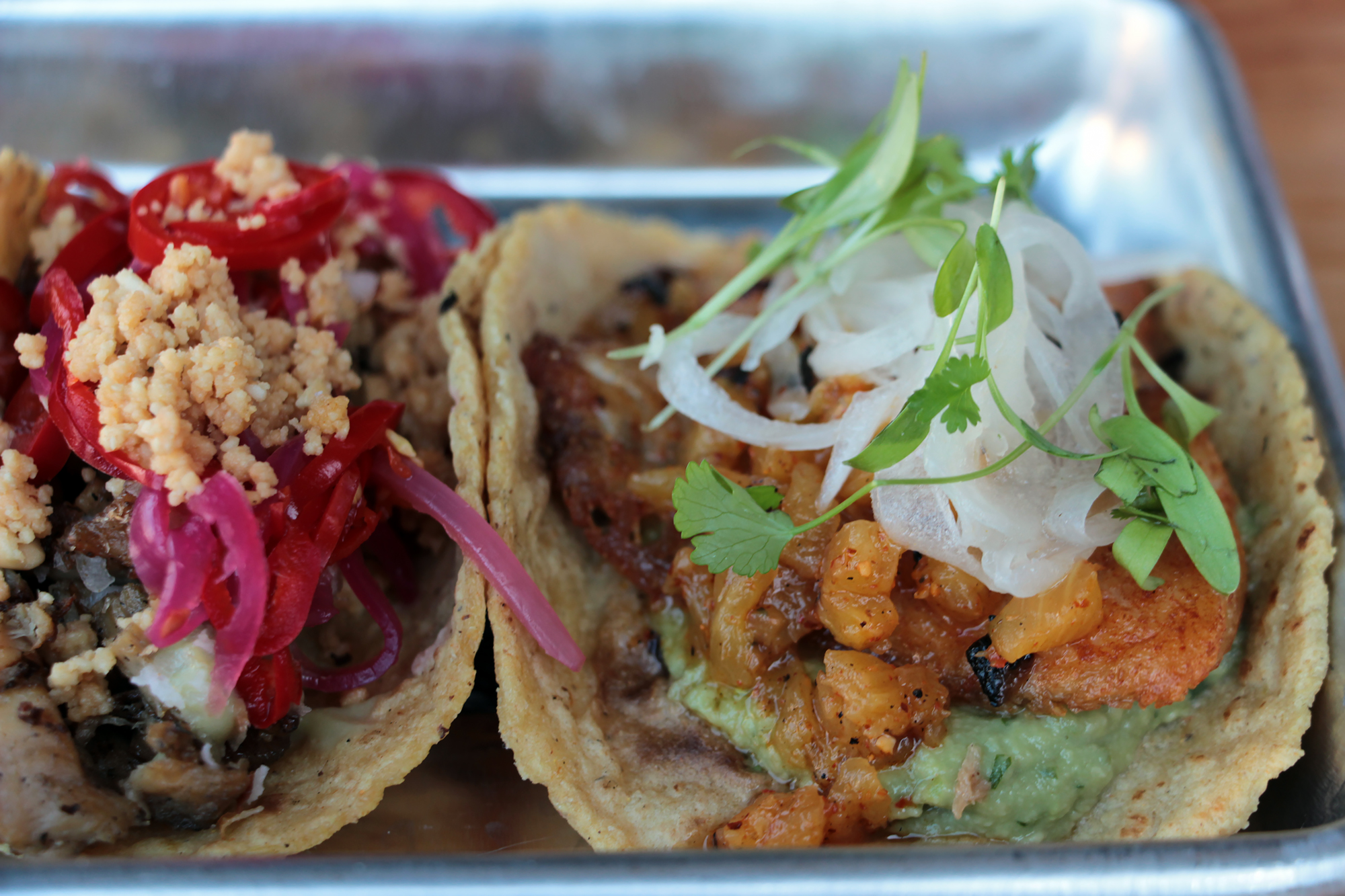 Pescado Al Pastor (R) and Khmer Lemongrass Chicken tacos.