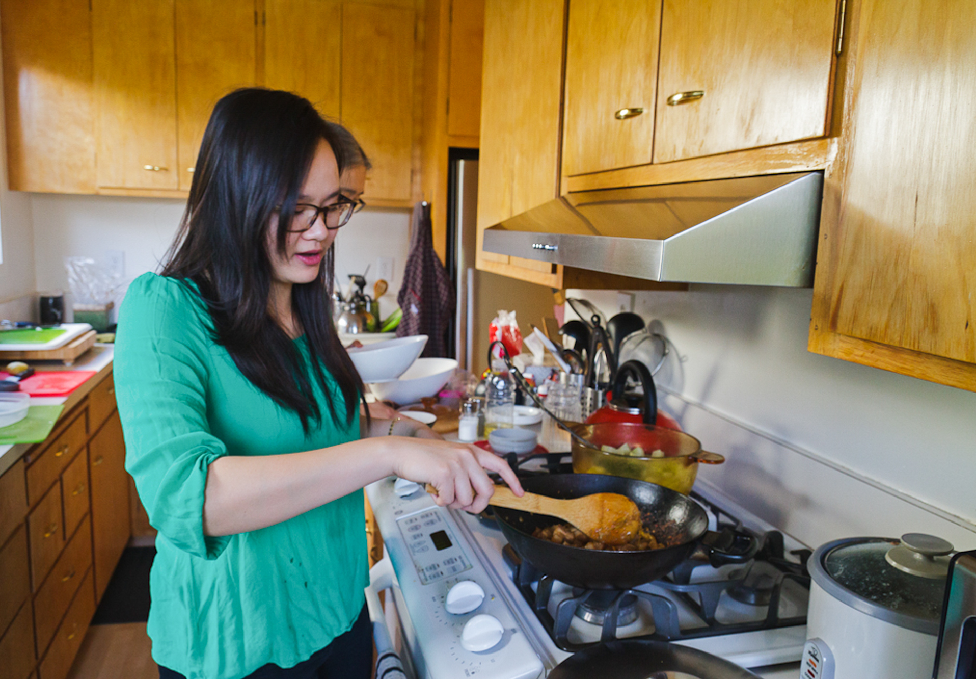 Khanh-Hoa Nguyen cooks caramelized pork belly with ginger, a Cambodian dish served to women who have just given birth.