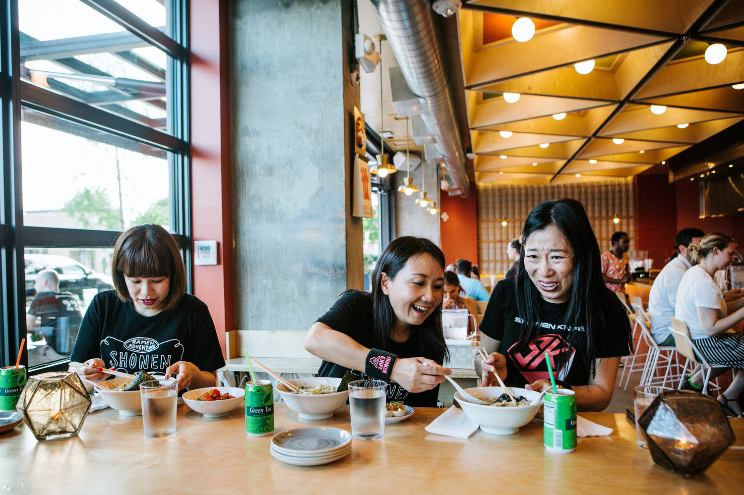 """(Left to right) Risa, Naoko and Atsuko of the band Shonen Knife eat ramen at Haikan in Washington, D.C., before playing a show. D.C. was one of their stops on a self-titled """"Ramen Adventure Tour"""" of the U.S. By night, they play gigs. By day, they sample ramen in cities across the country."""