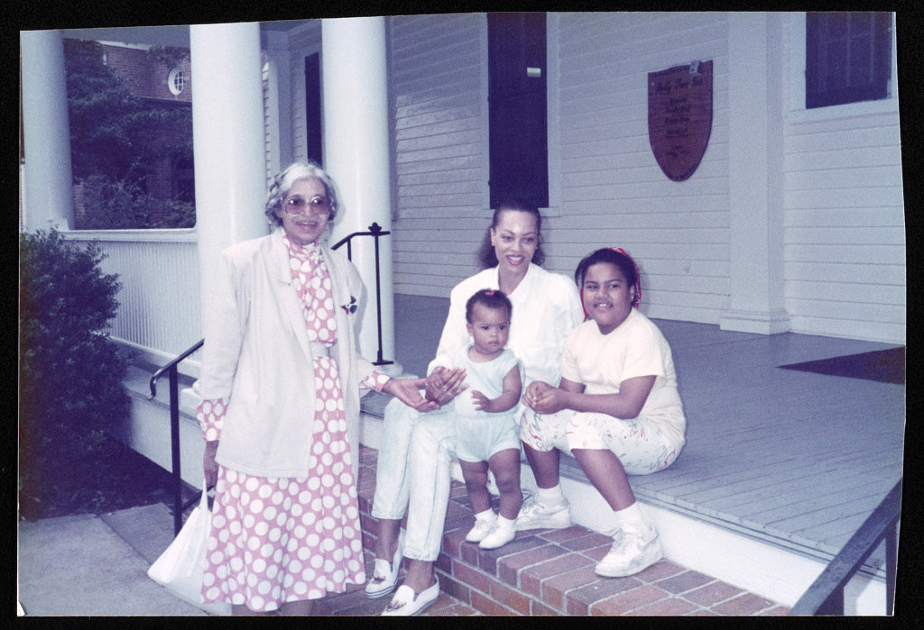 Rosa Parks with her niece Susan McCauley and family outside the Holly Tree Inn in Hampton, Va., 1989
