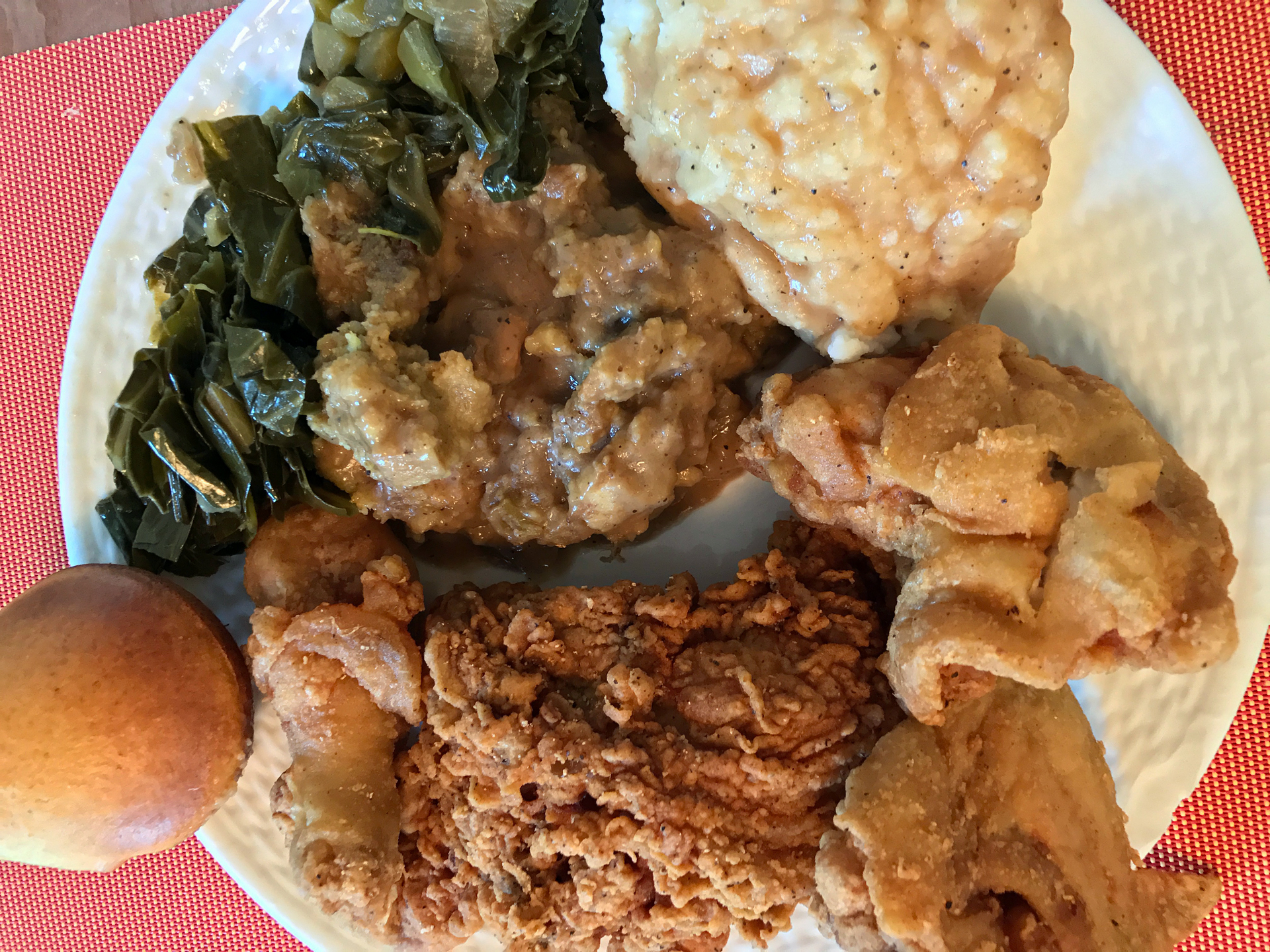 A heaping plate of fried chicken and fixins at Touch of Soul in Oakland.