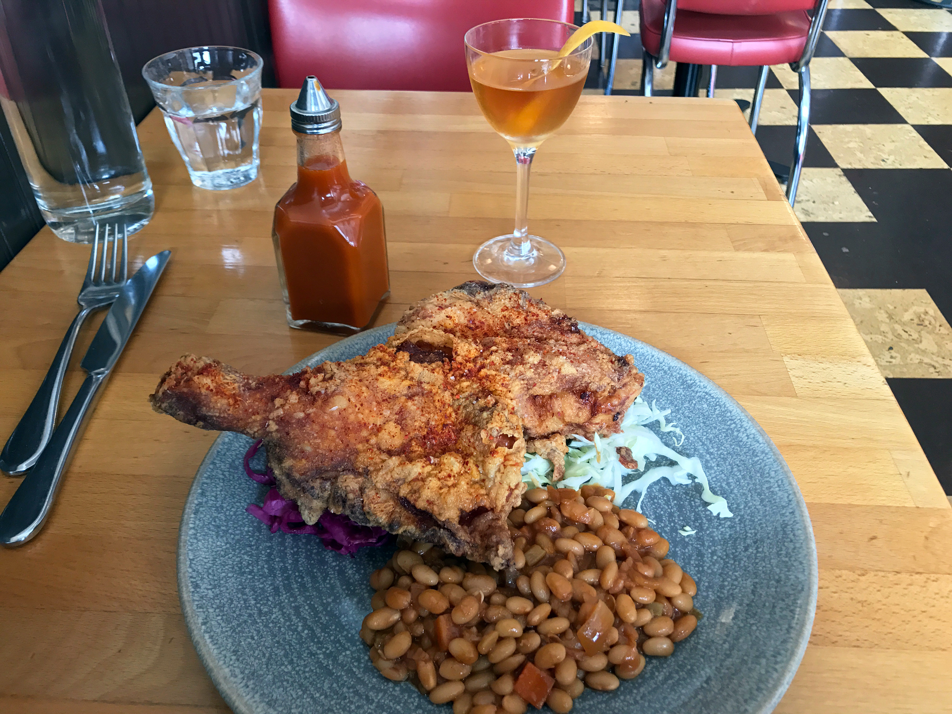 Hopscotch's fried chicken with baked beans and coleslaw.