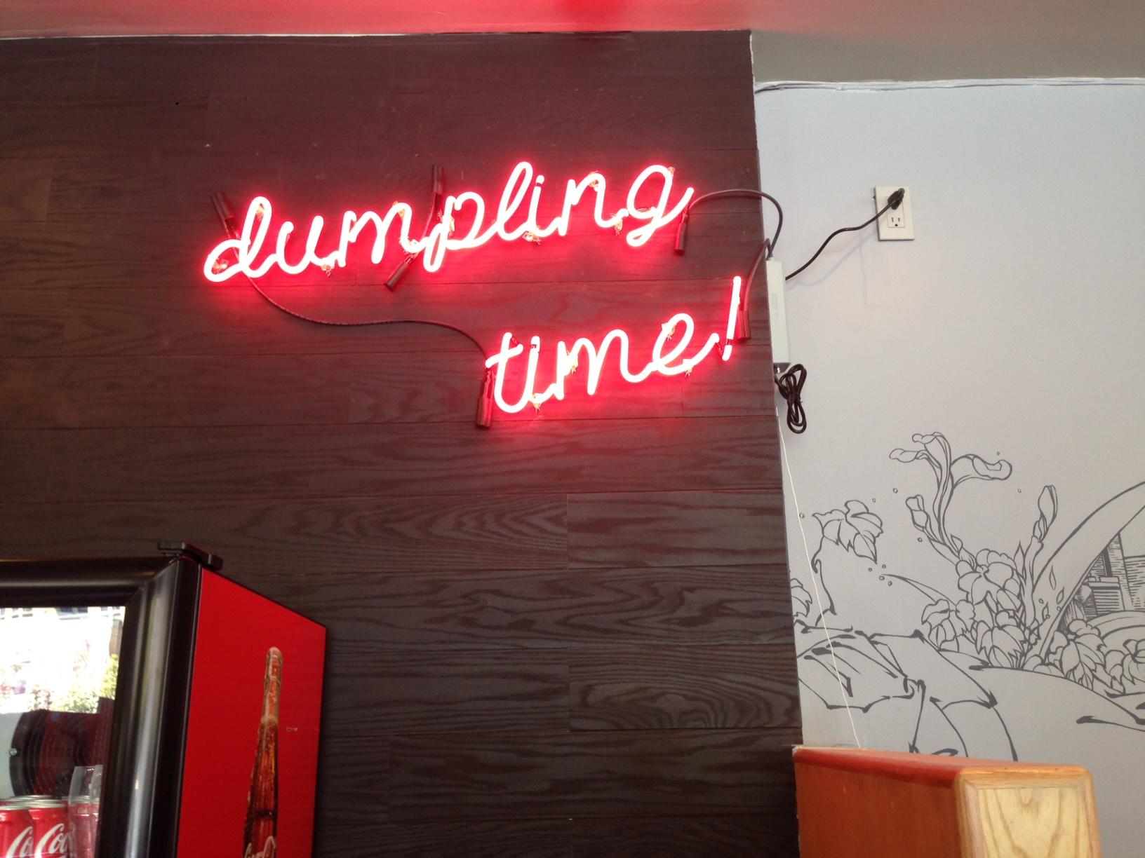 Dumpling Time neon sign.