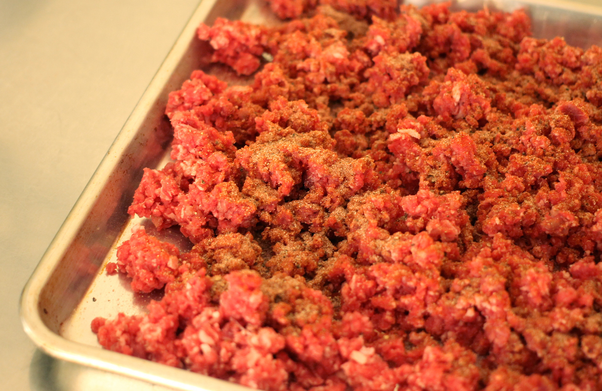 Ground beef with salt, paprika, pepper, garlic powder, and onion powder — no nitrates.