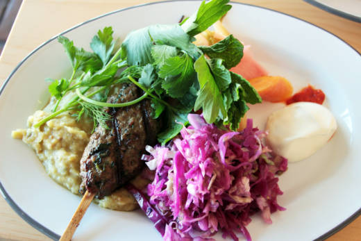 Lamb Kebab Plate with served with homemade purple-cabbage sauerkraut, mashed lentils, and pickles of fennel, carrot and celery.