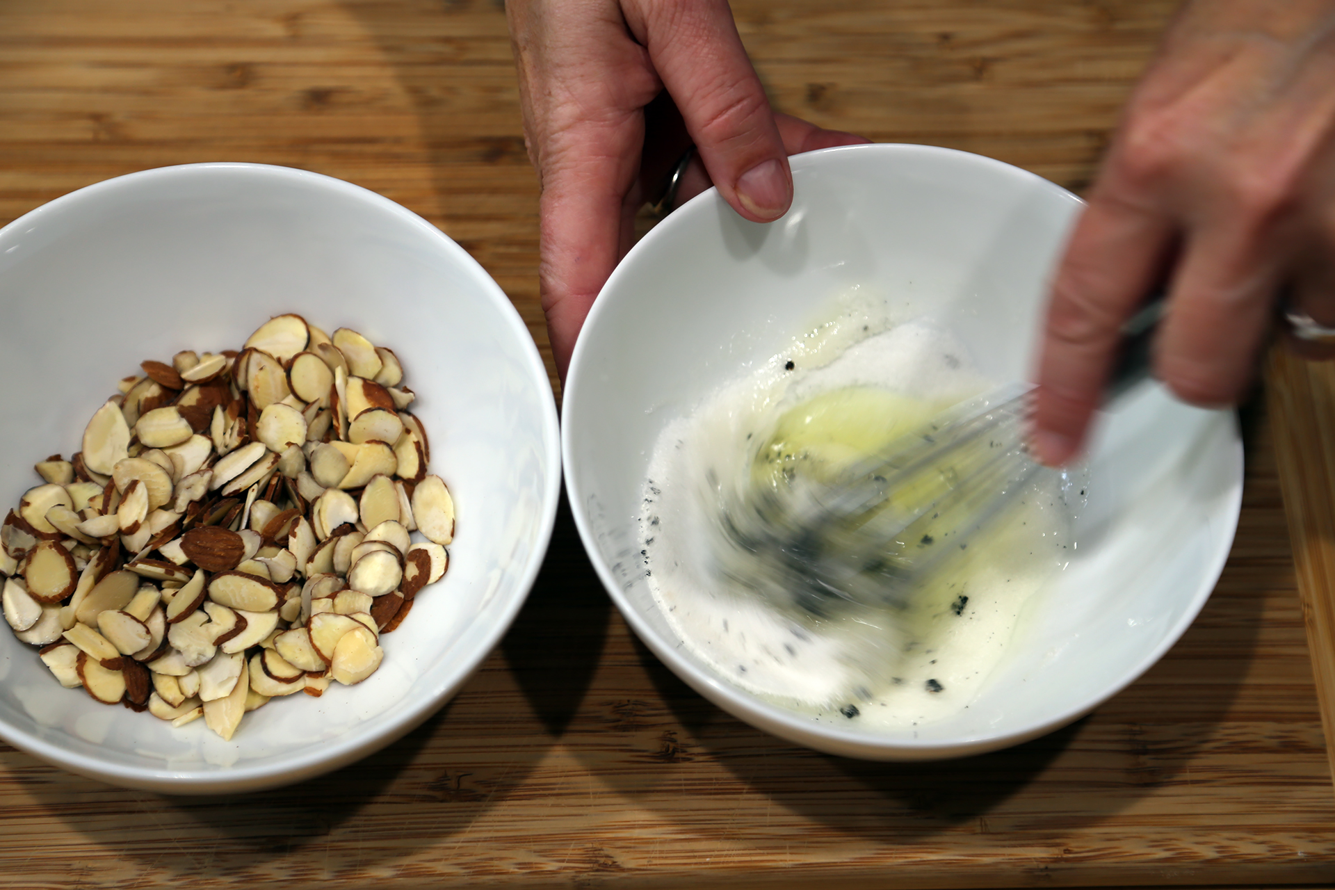 To make the almond crackle, add the egg white, sugar, and salt to the bowl with the vanilla bean seeds and whisk just until frothy (you aren't actually whipping the whites, you are simply breaking them up) and the vanilla seeds are evenly dispersed.