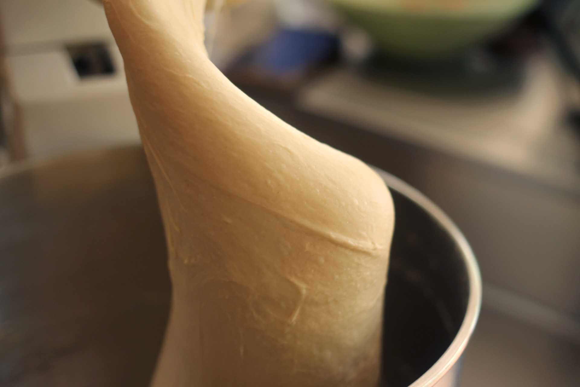 The fully kneaded dough should be smooth and stretchy.