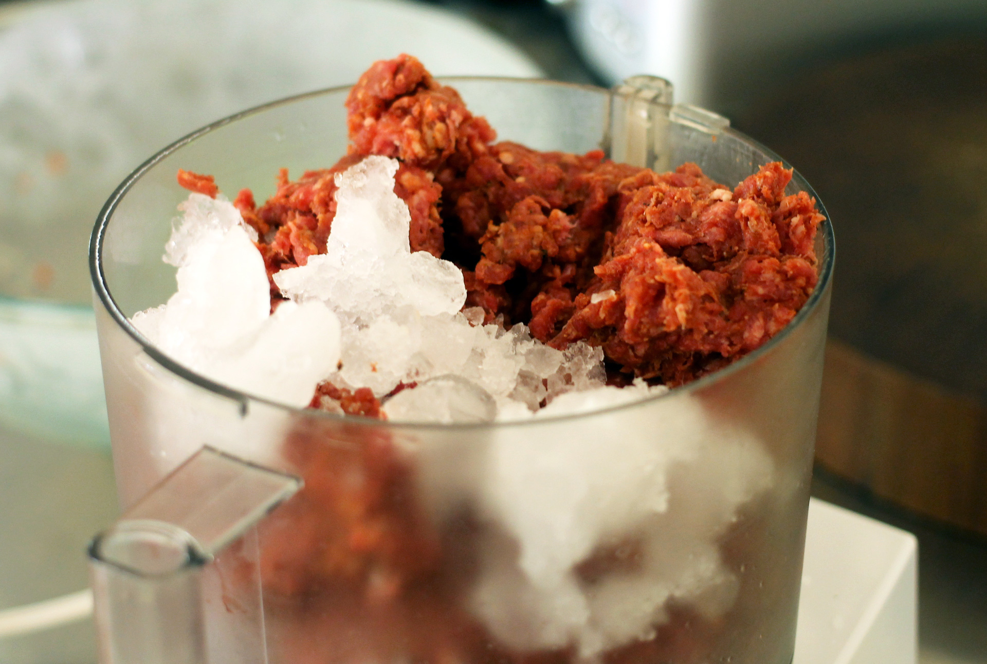 This amount of meat and ice will overflow out of a standard-sized food processor and make a giant mess.