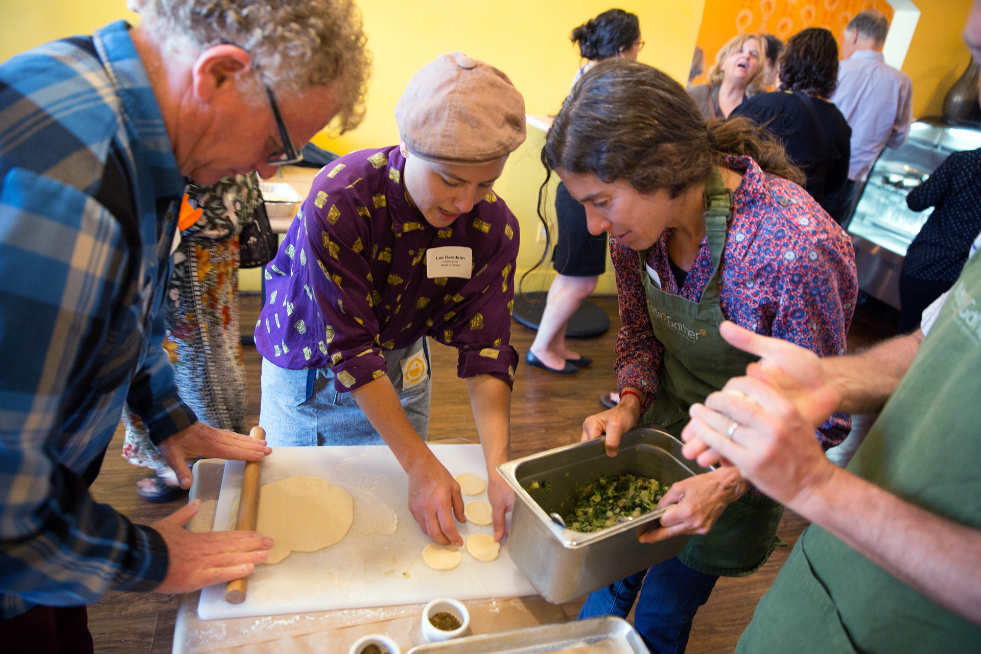 Chef Lee Davidson (center) instructs Peter Levitt, executive chef and co-owner of Saul's Deli and Wendy Goodfriend, senior interactive producer and experience architect at KQED, in fatayer-making at a recent Illuminoshi event at Ba-Bite in Oakland.