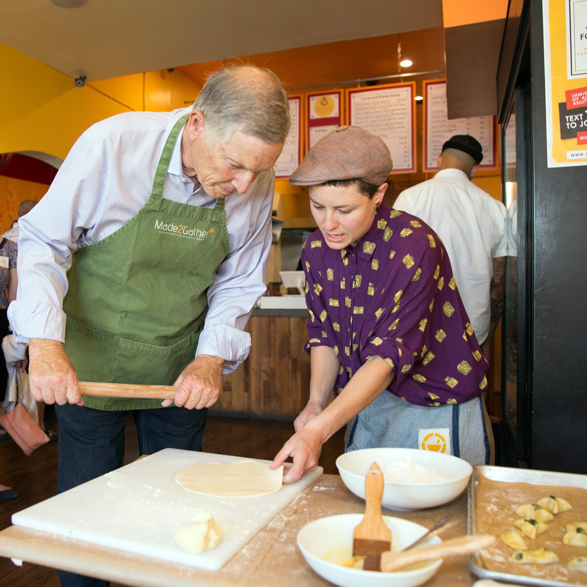 Chef Lee Davidson instructs David Tussman on how to make a fatayer.