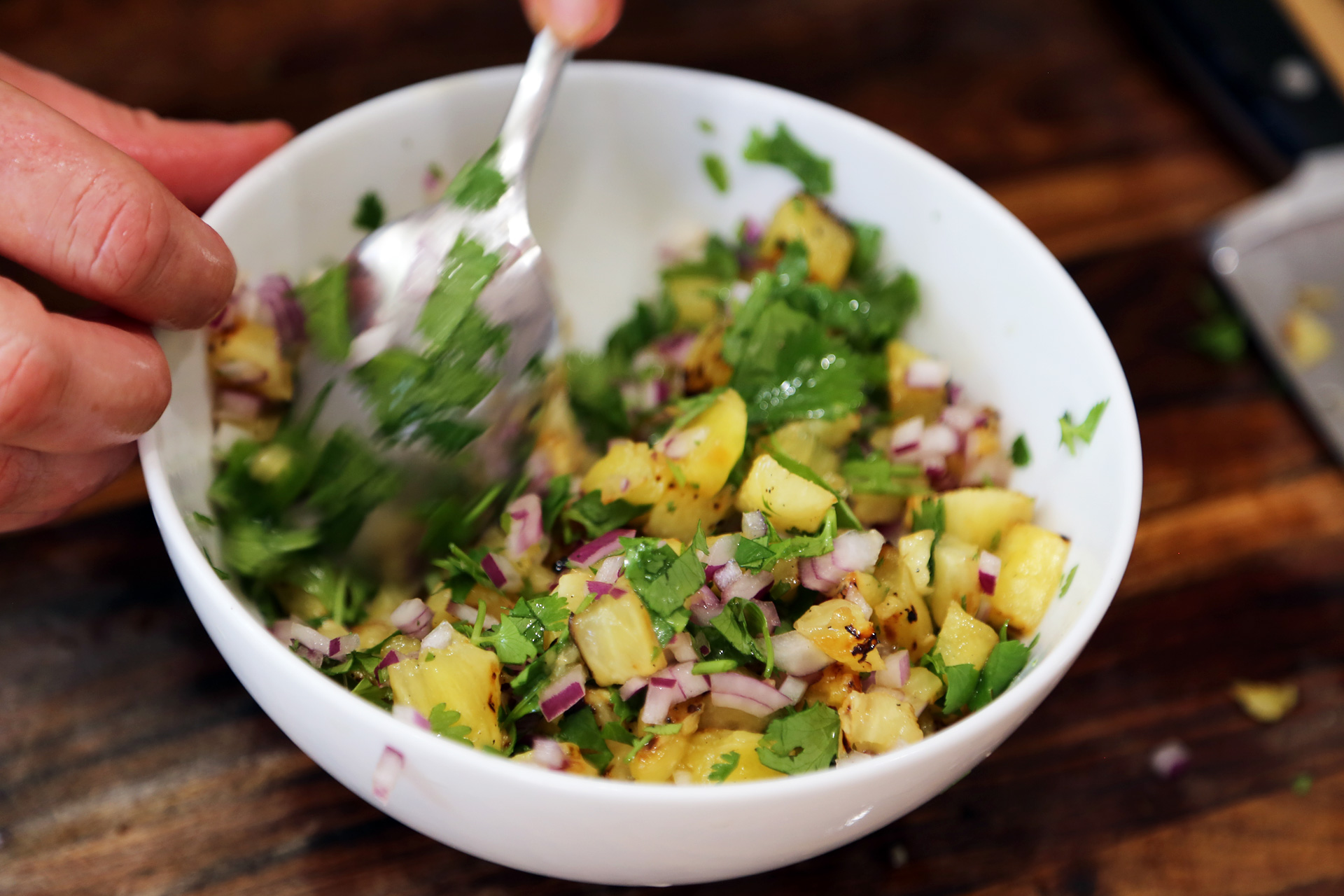 Toss pineapple with the red onion, cilantro, jalapeno if using, and lime juice and set aside.