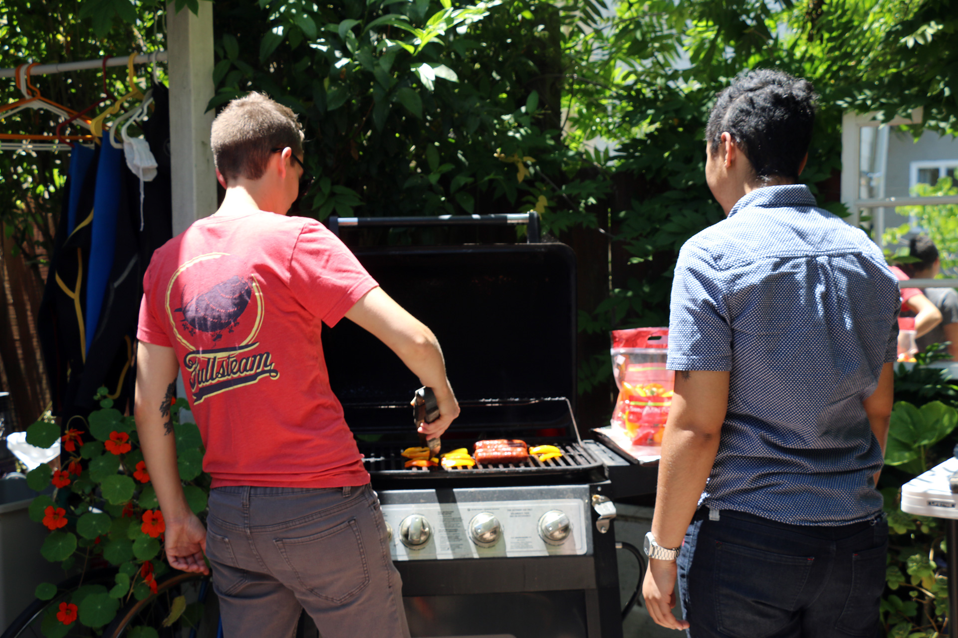 Summerhill grills up hot dogs for the group.