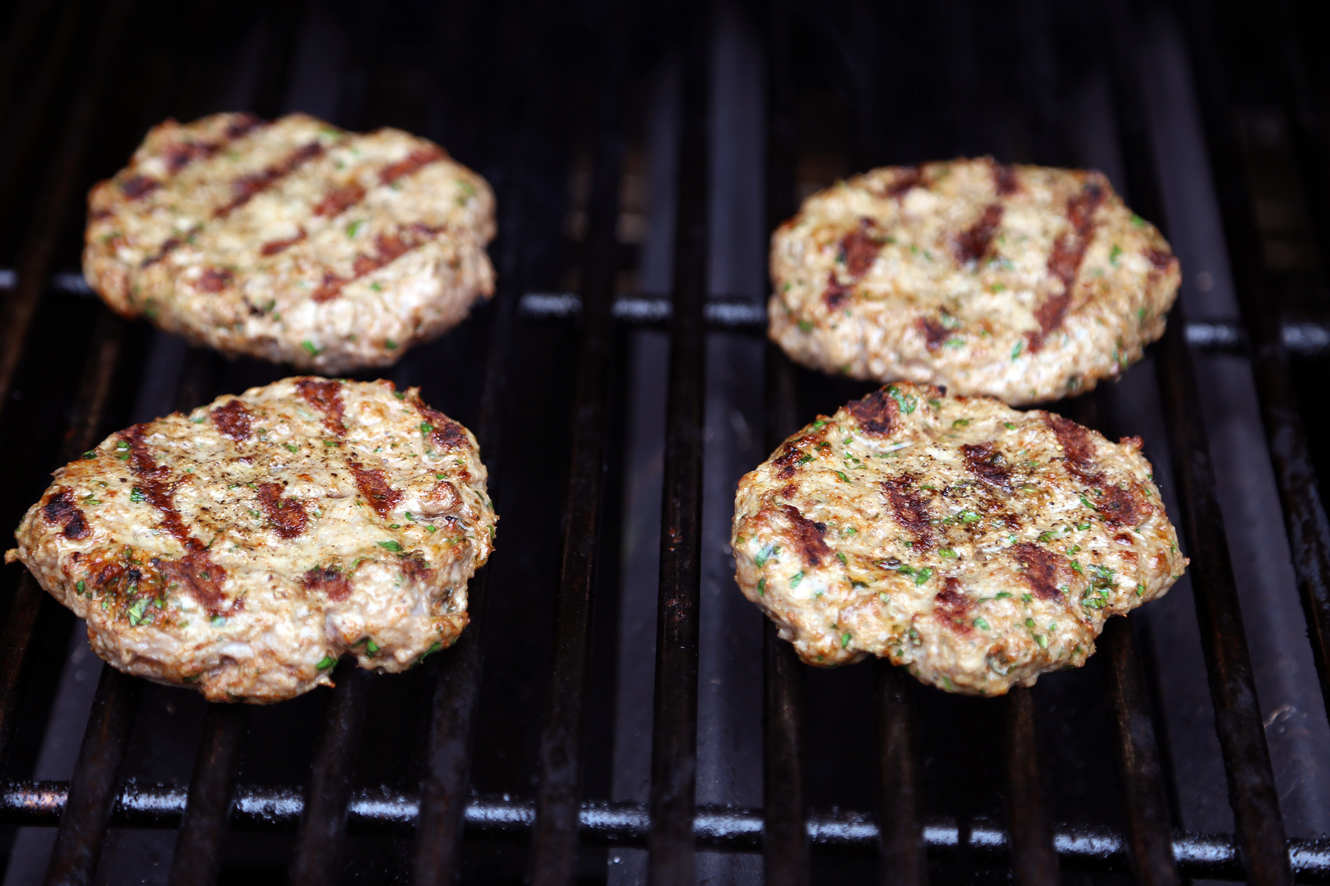 Grill the patties until nicely seared on both sides, turning occasionally, about 4 minutes on each side.